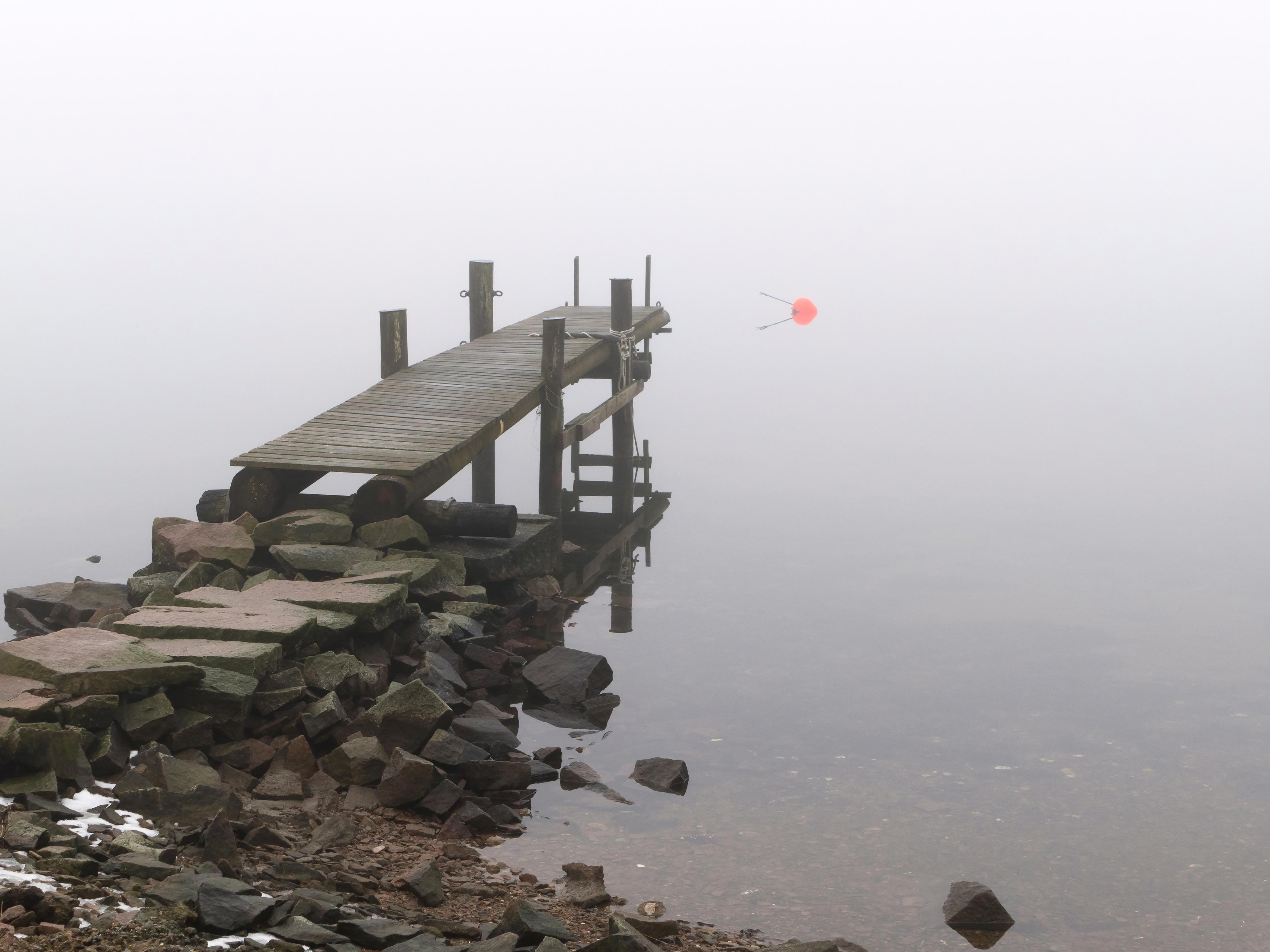 Jetty in fog at holländaröd 2 photo