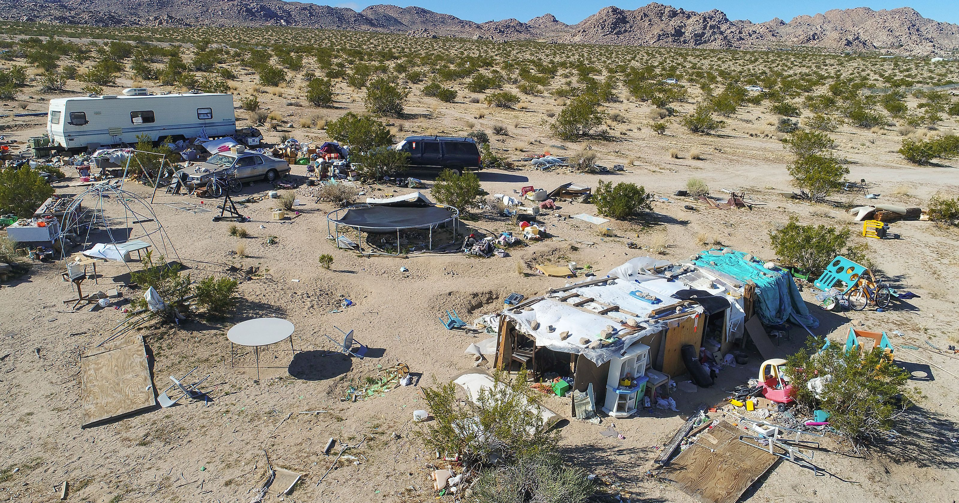 Joshua Tree shack surrounded by feces, stray cats and junk
