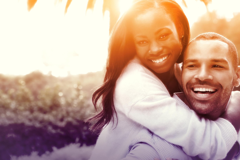 Joyful couple hugging in love - colorized photo