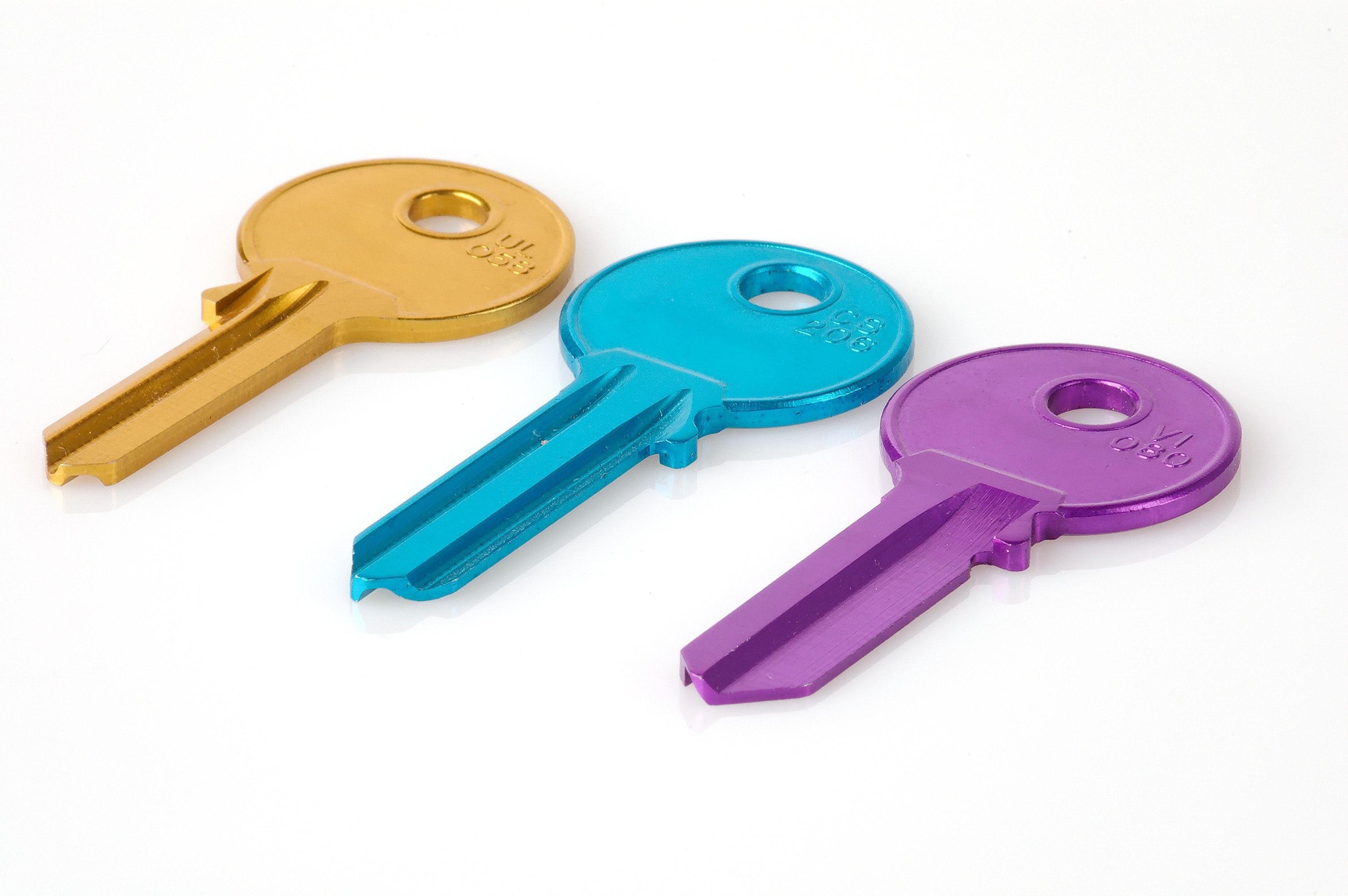 Three Keys in a White Background Photo · Free Stock Photo