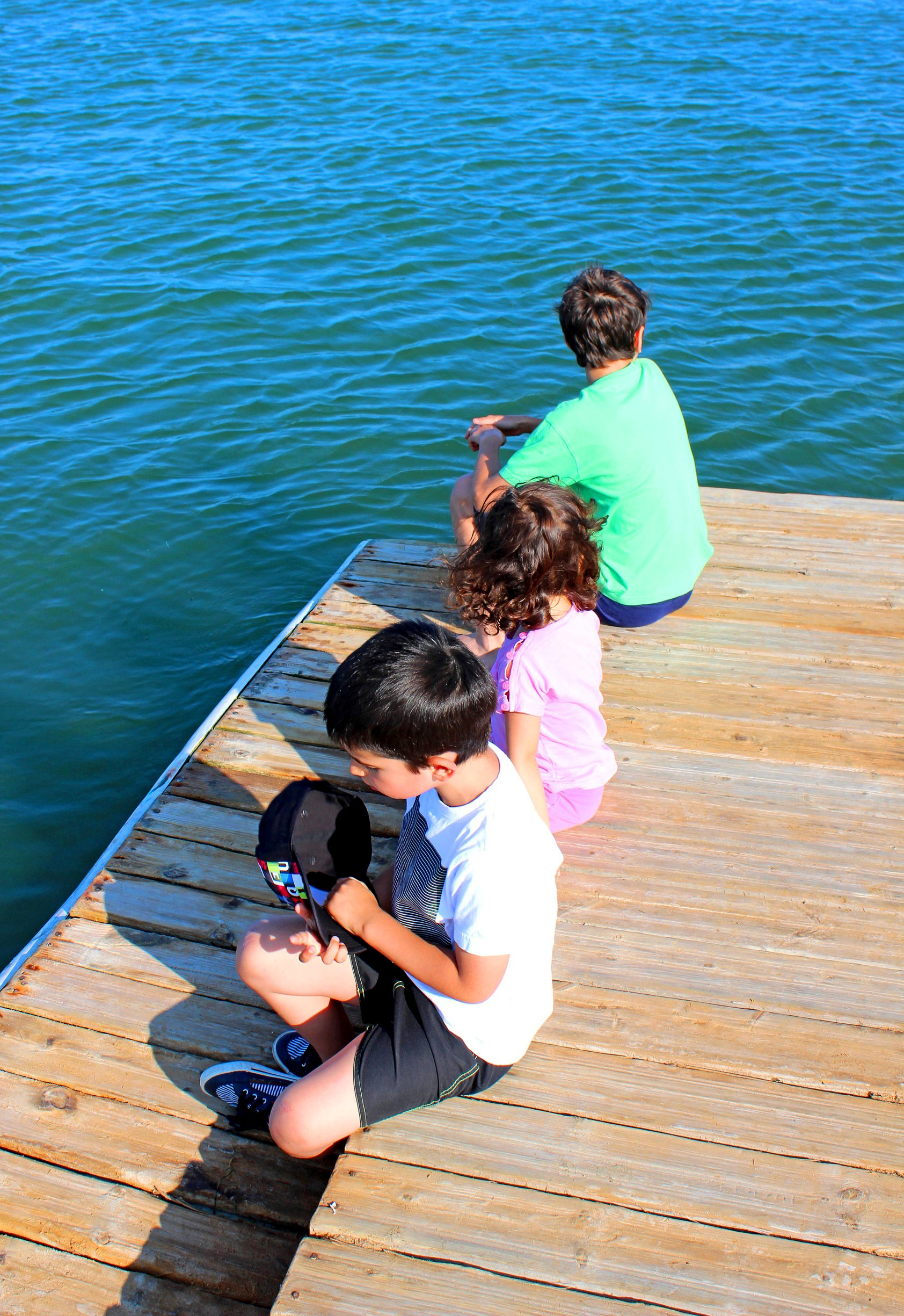 Kids aloof on the pier photo