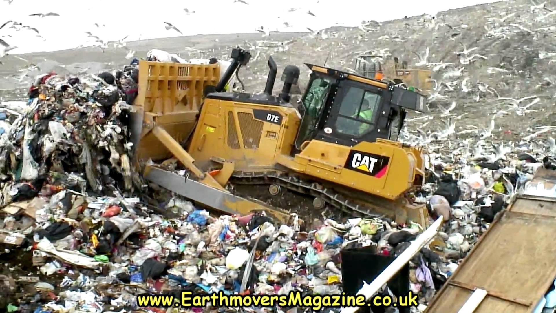 Cat D7E Hybrid dozer in landfill - YouTube