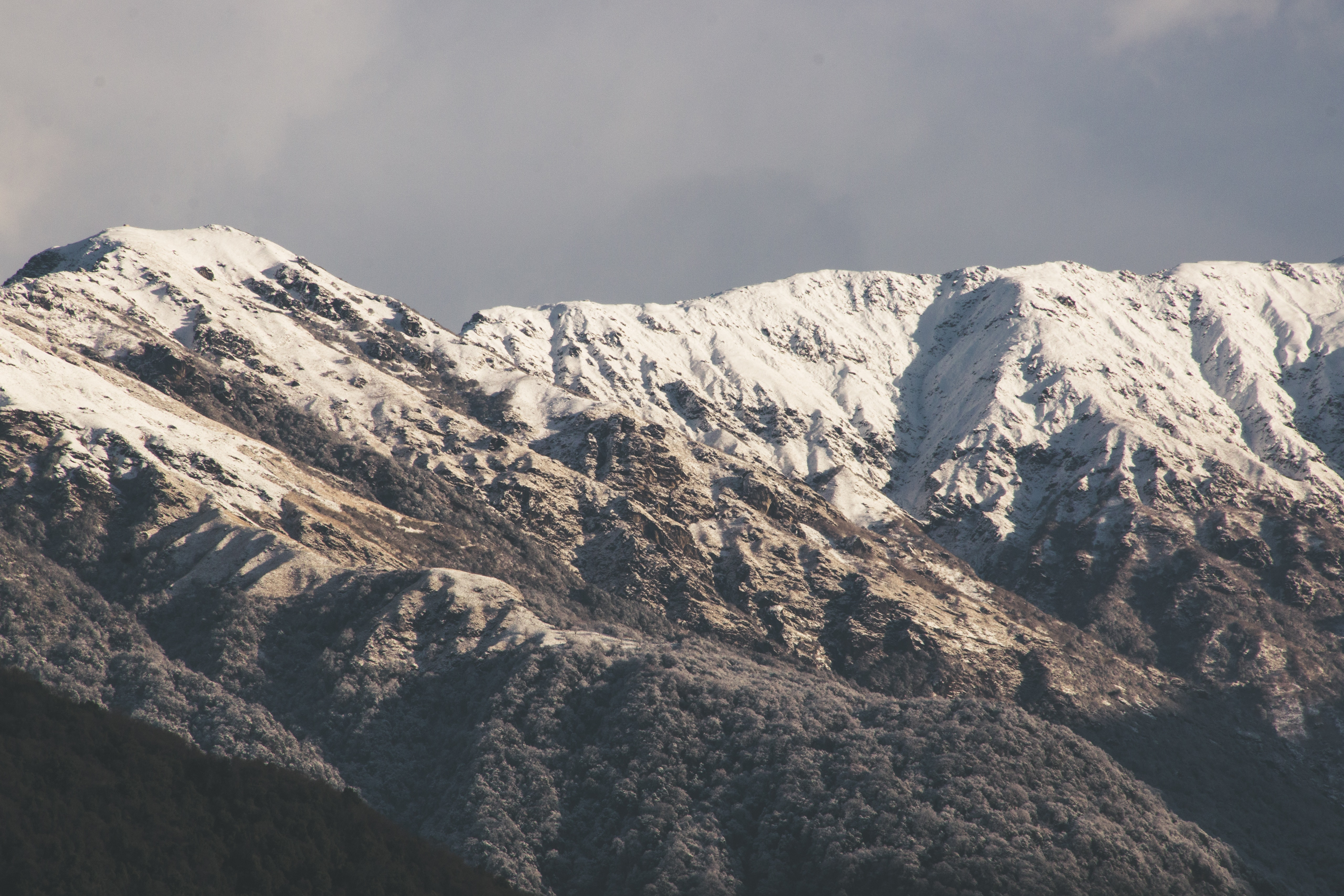 Landscape photograph of snow-capped mountains