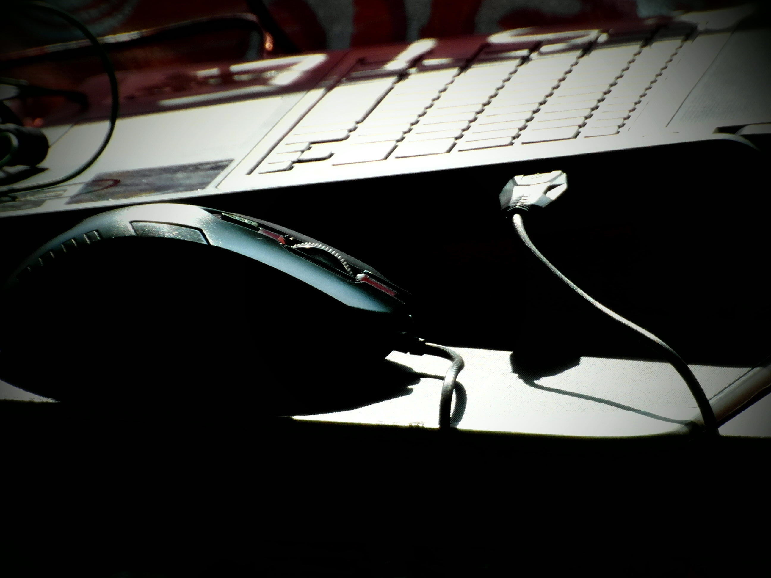 Laptop and mouse in shadows photo
