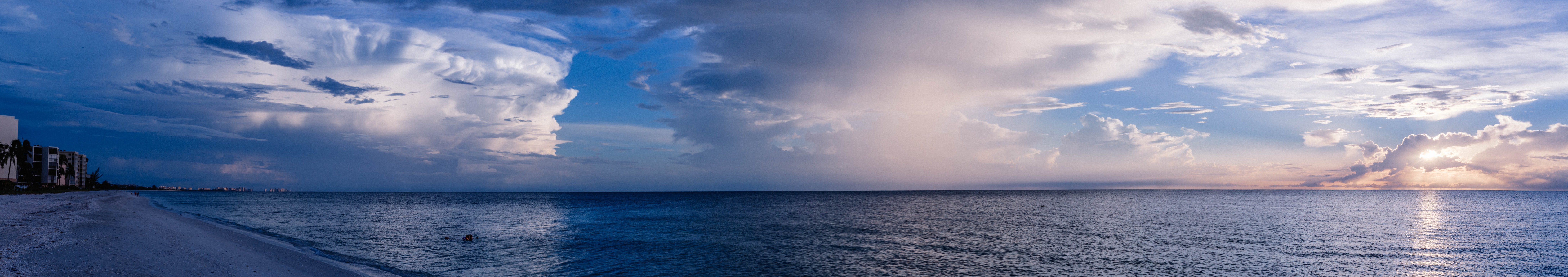 Large body of water under cloudy sky photo