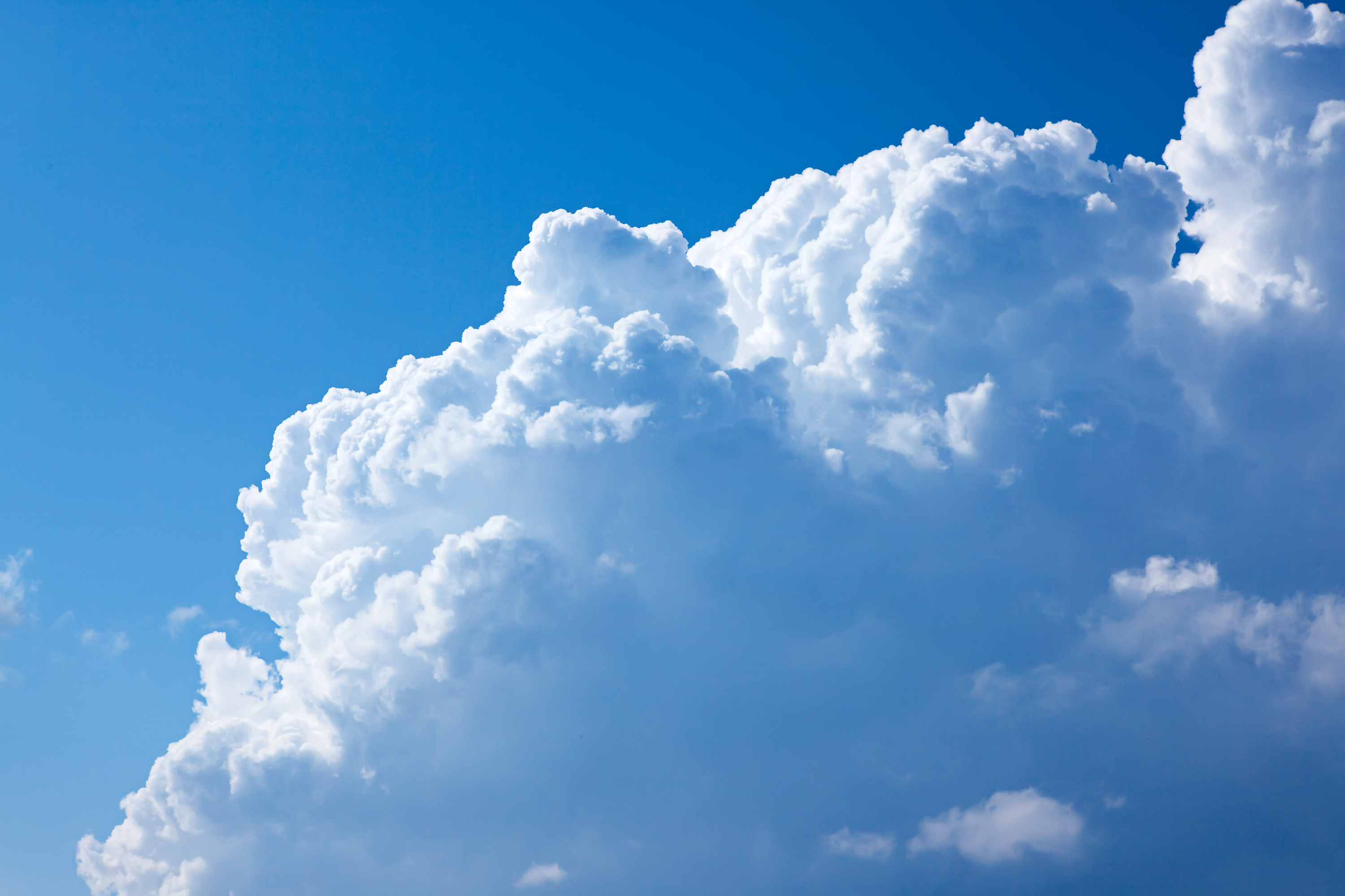 Large cloud in blue sky photo