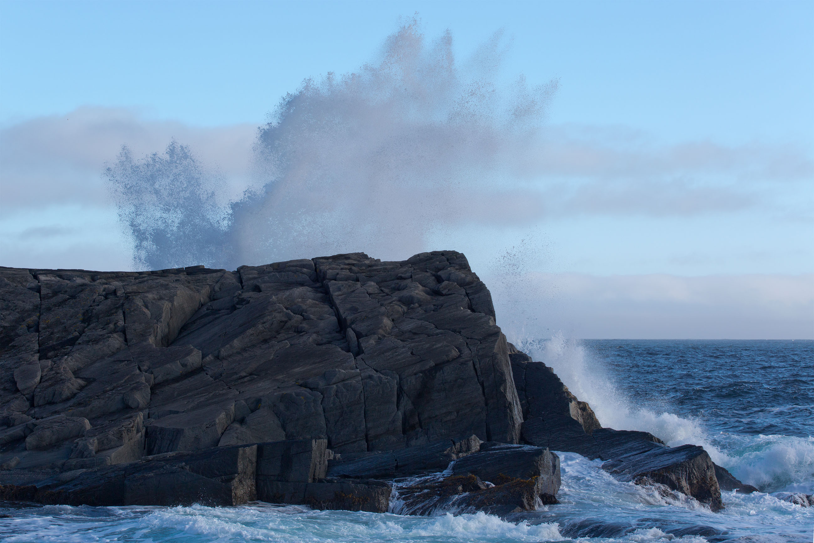 Large waves crashing on shoreline photo