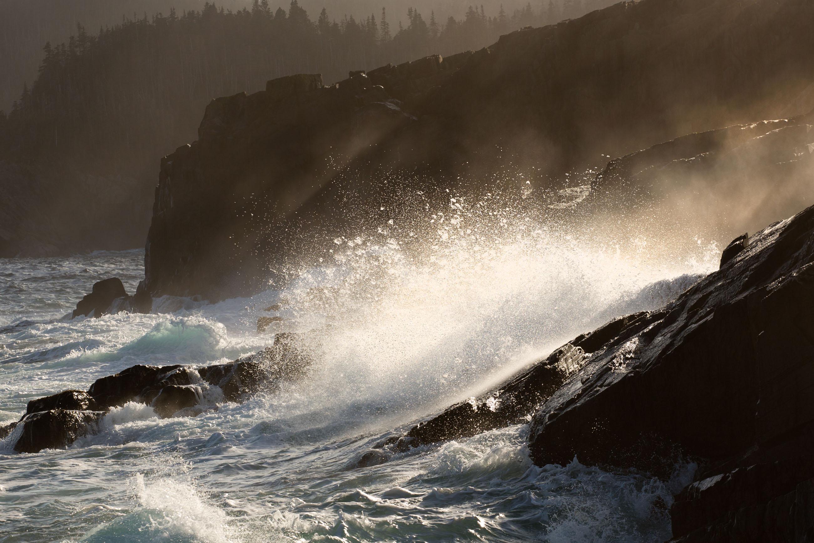 Large waves crashing on shoreline photo