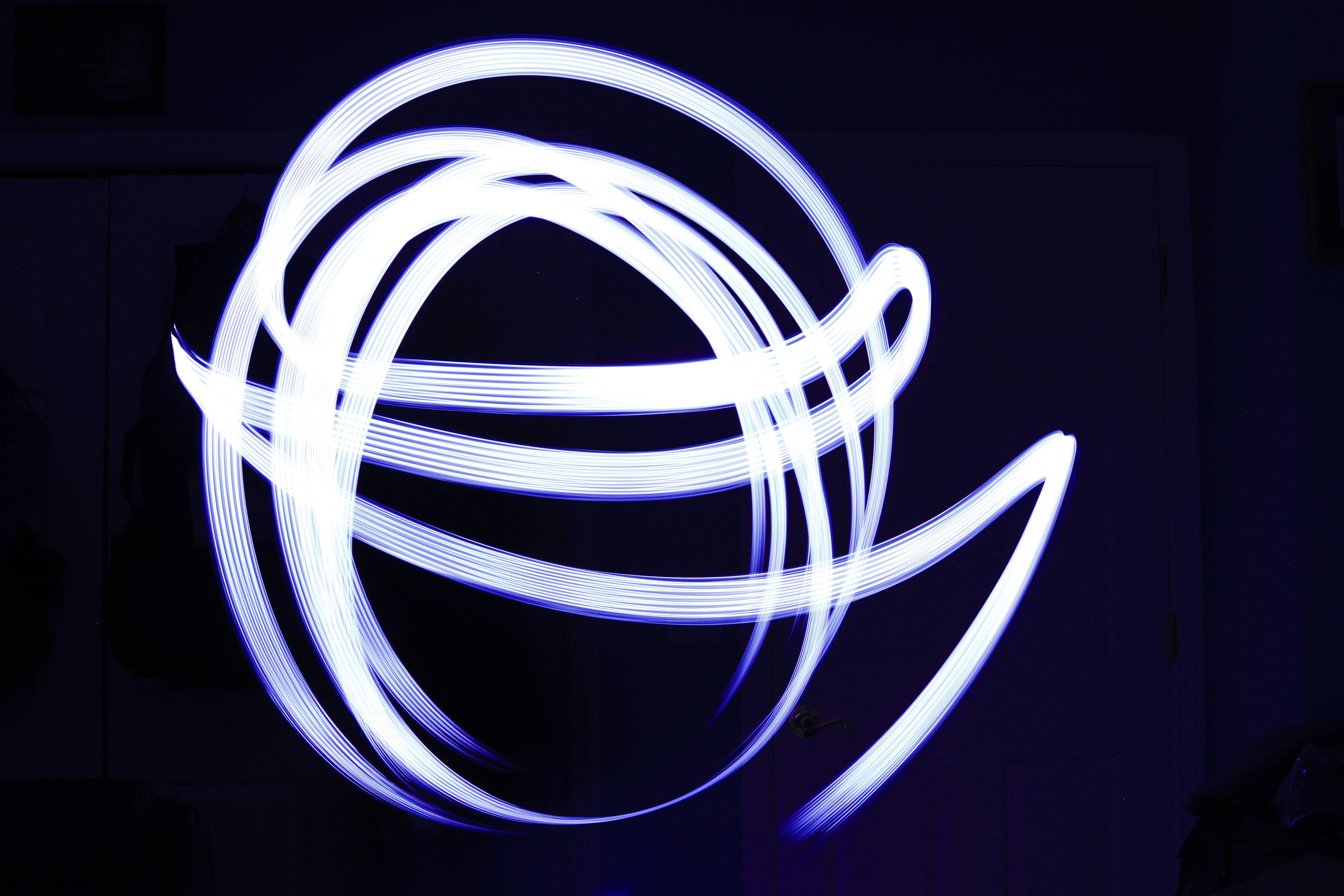 LED flashlight, painting or moving light., Black background, Circle, Flashlight, Led, HQ Photo