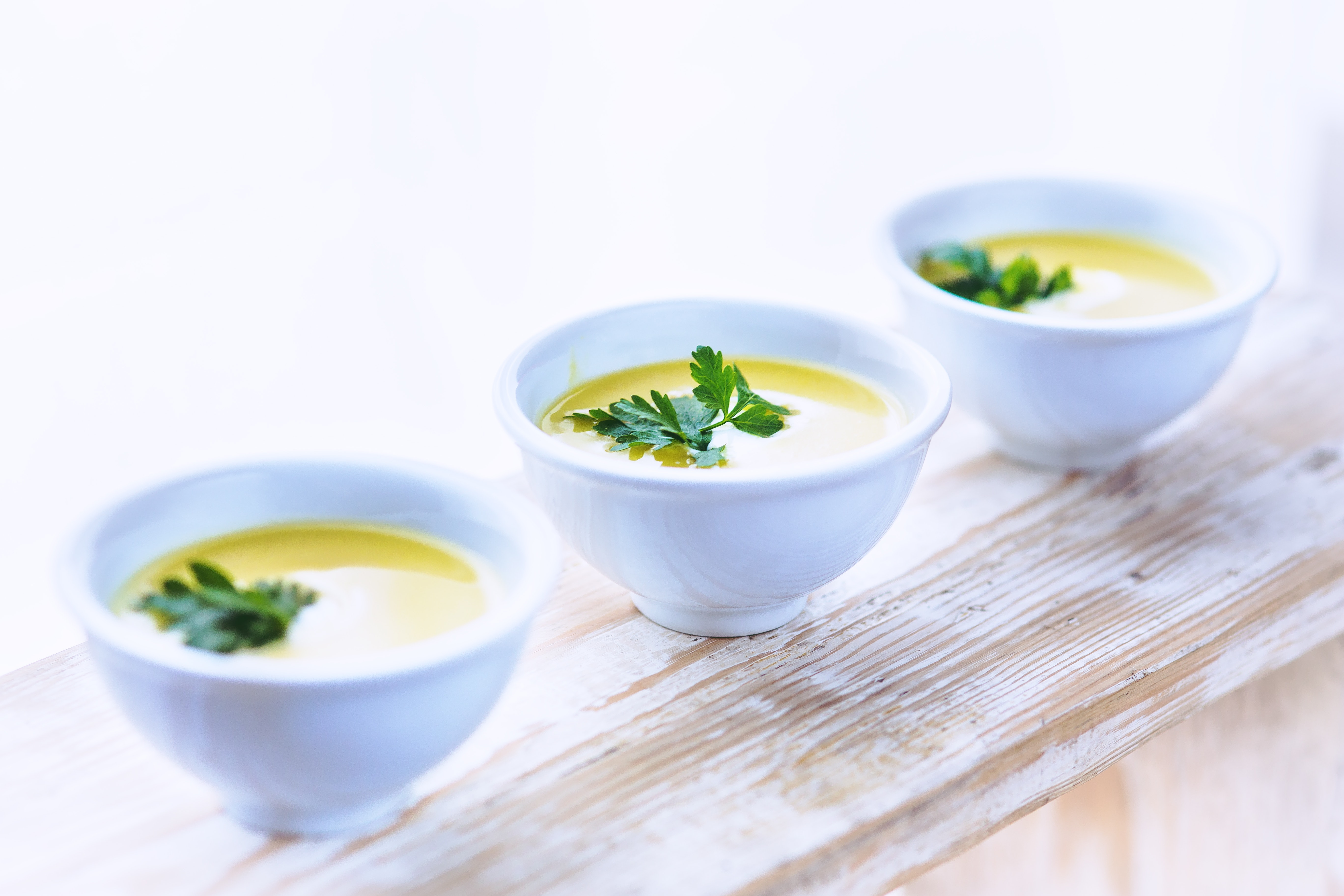 Leek and potato soup with parsley photo