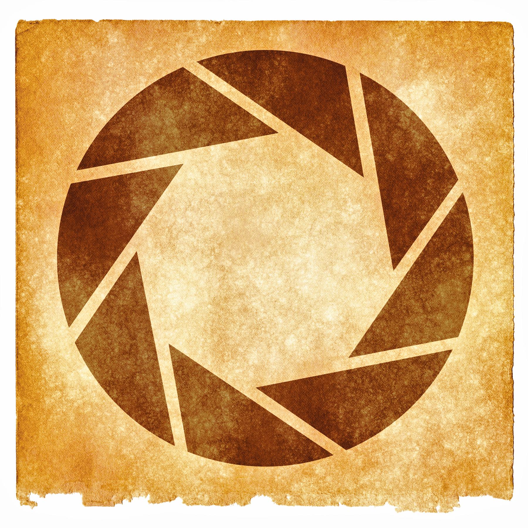 Lens aperture grunge symbol - sepia photo