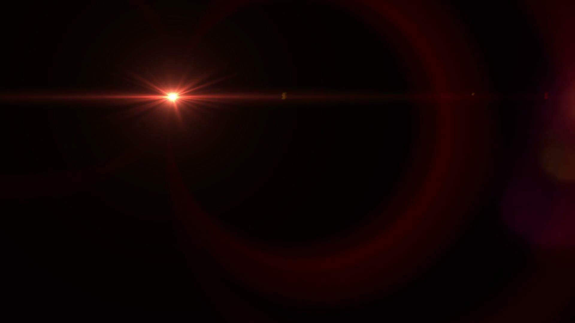 Digital red lens flare light over black background motion. easy to ...
