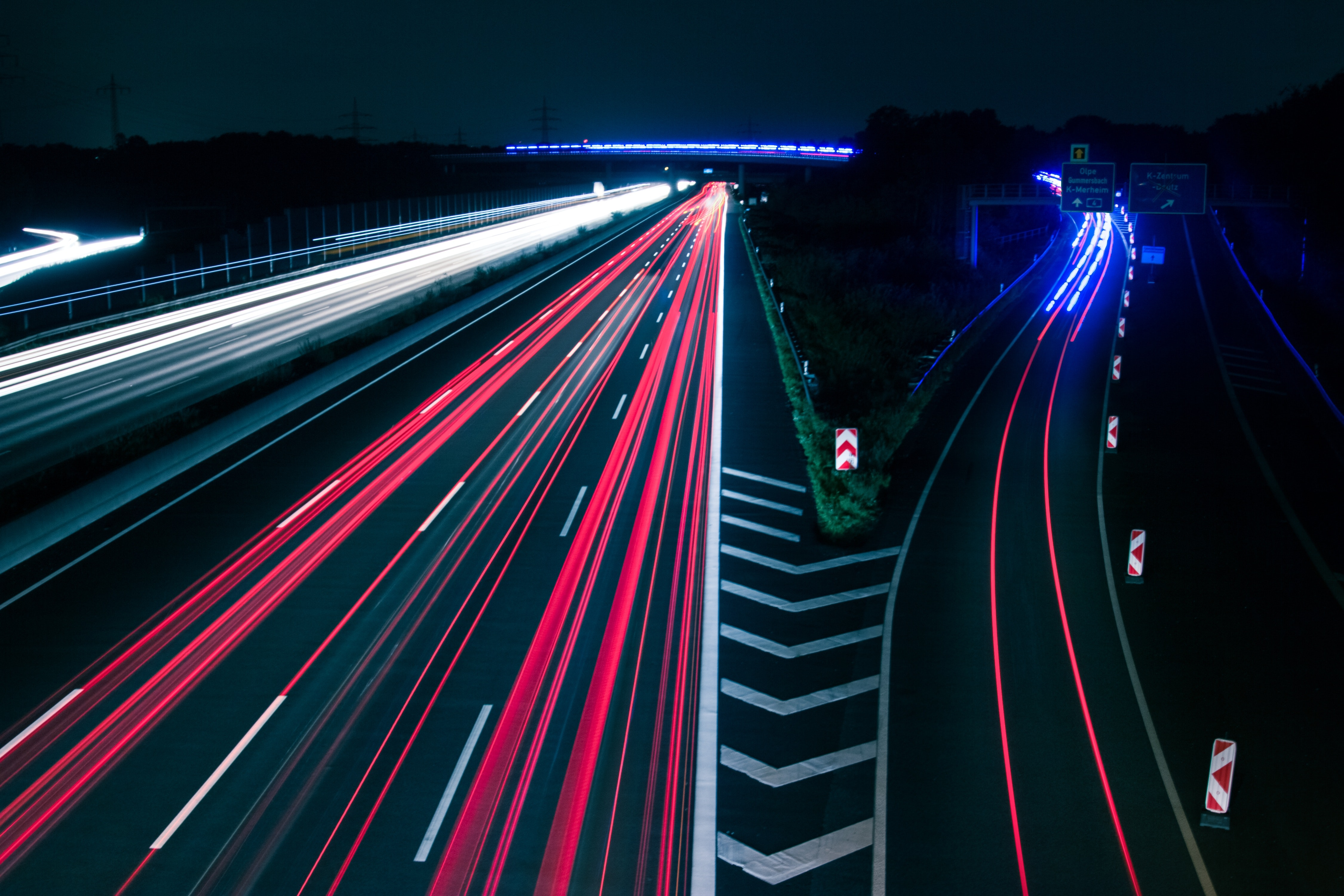 Light trails on road at night photo