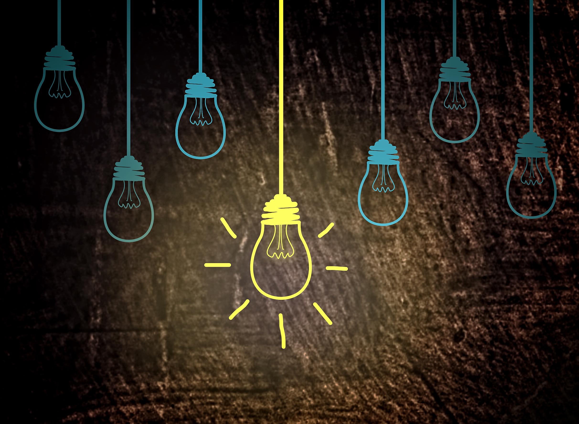 Lightbulbs on wood - creativity concept photo