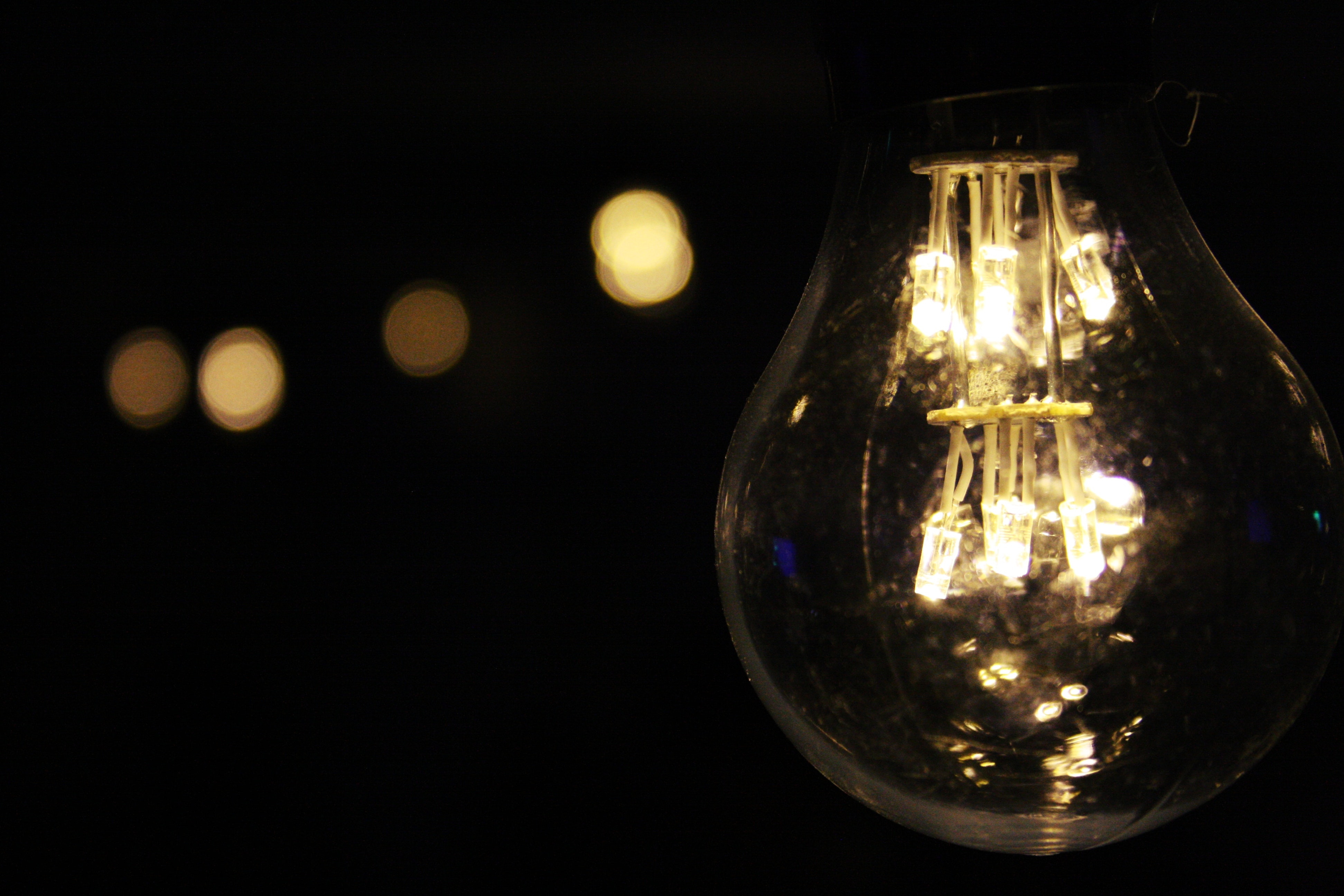 Lighted bulb during night time photo
