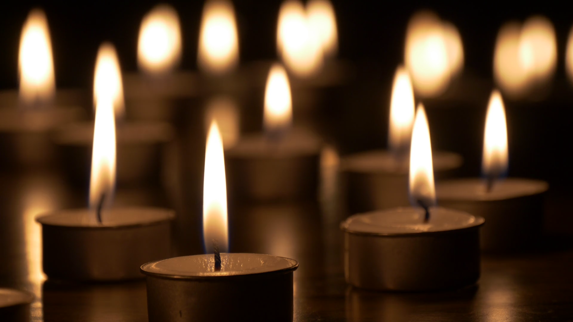 Small lighted candles in dark, bokeh candlelight Stock Video Footage ...
