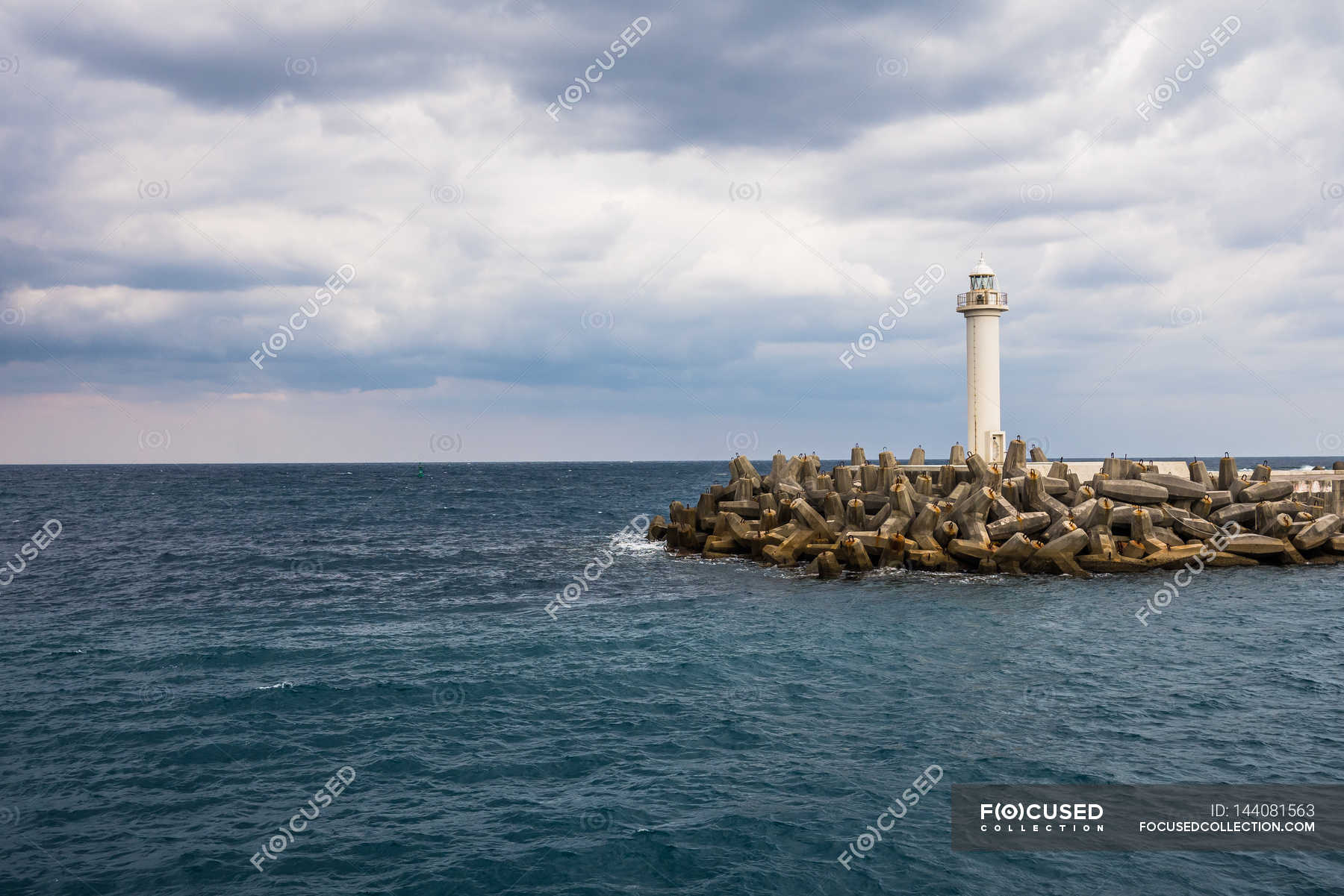 Lighthouse in sea at Naha Port — Stock Photo | #144081563