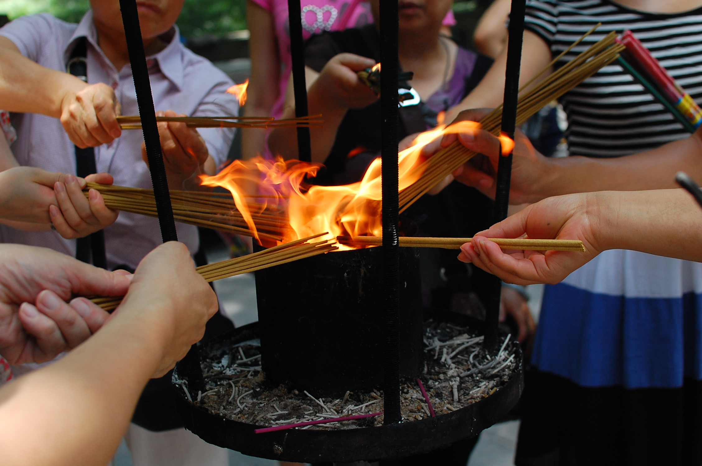 Lighting up incense at temple photo