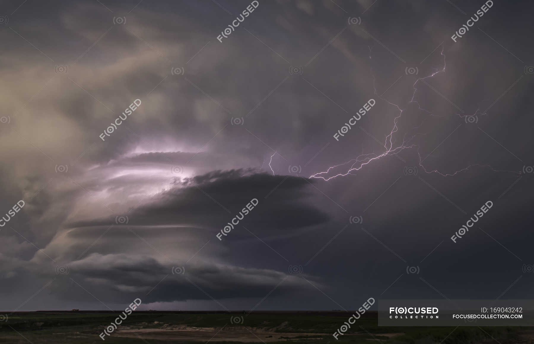 Ominous storm clouds with lightning above land — Stock Photo ...