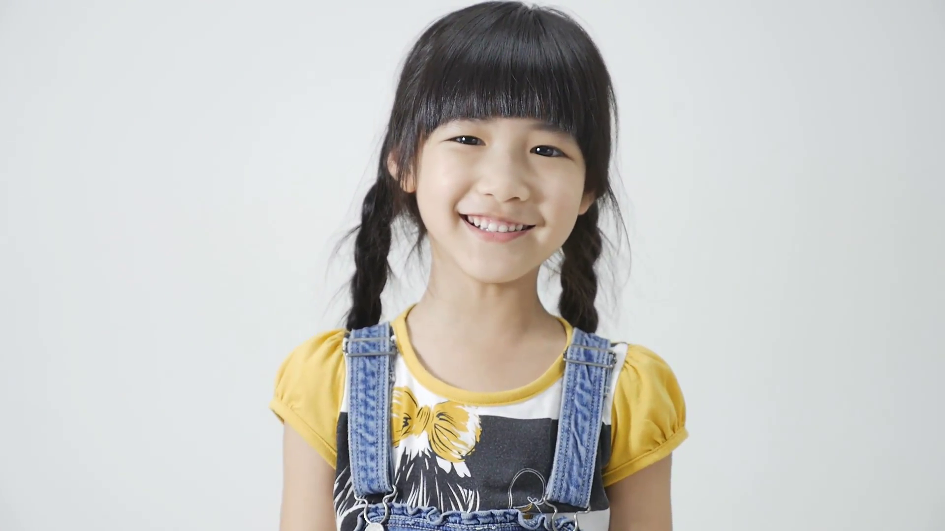 Little Asian girl is smiling on white background Stock Video Footage ...