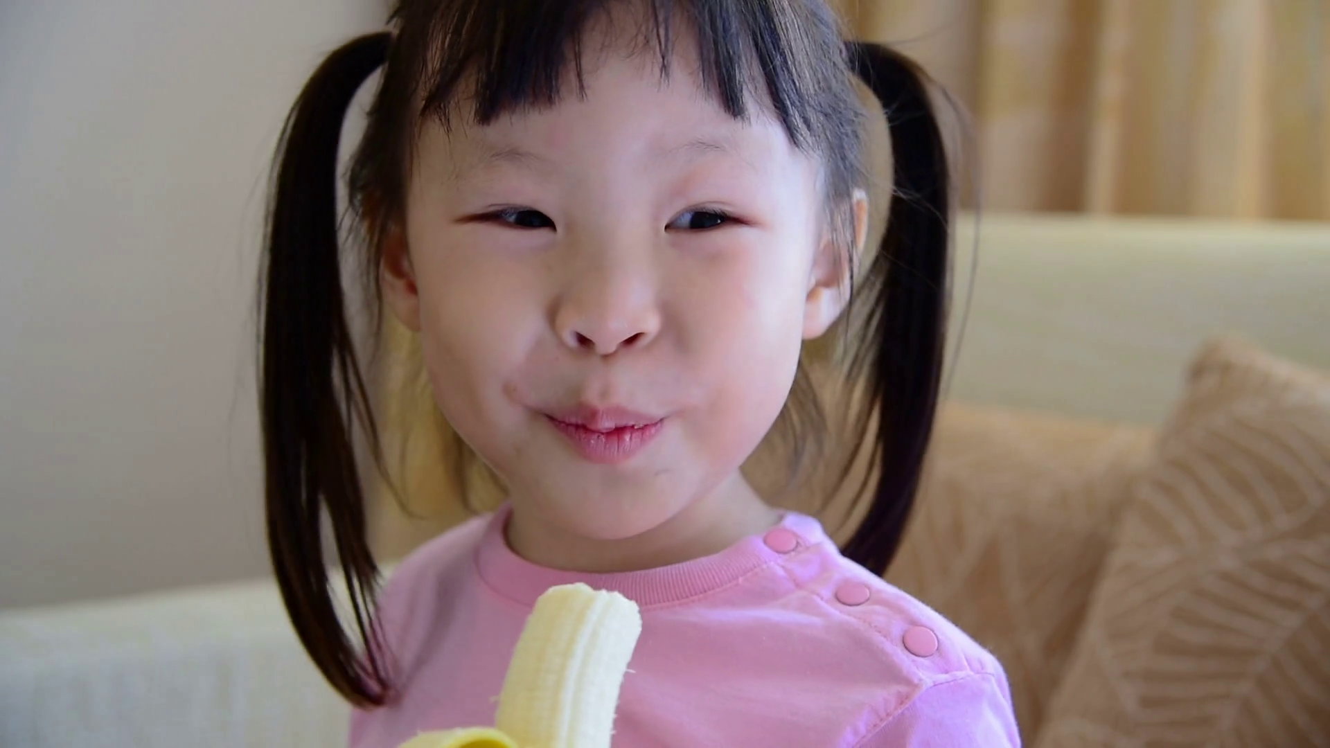Little asian girl eating banana Stock Video Footage - VideoBlocks