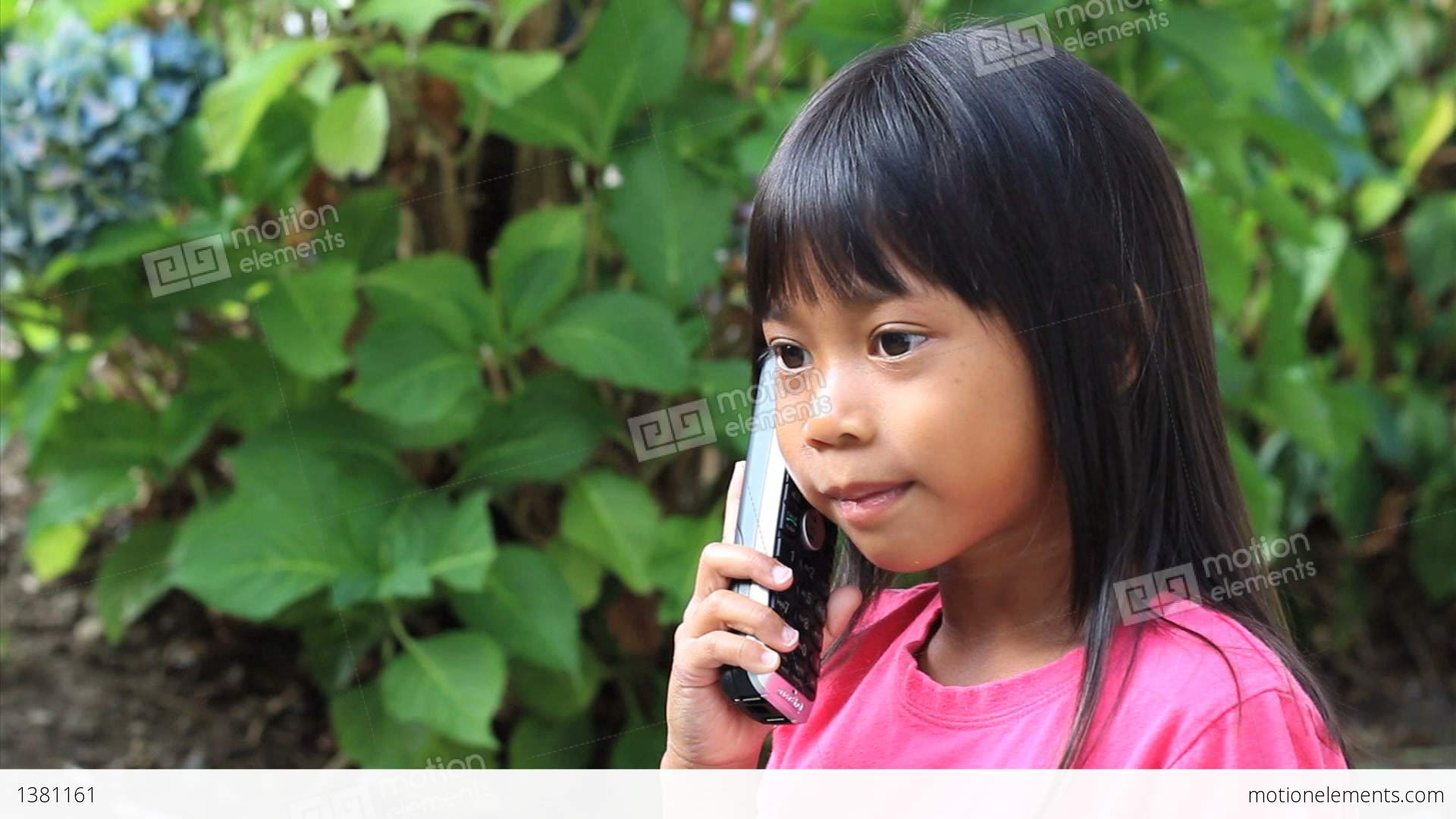 Little Asian Girl Talking On Phone Stock video footage | 1381161