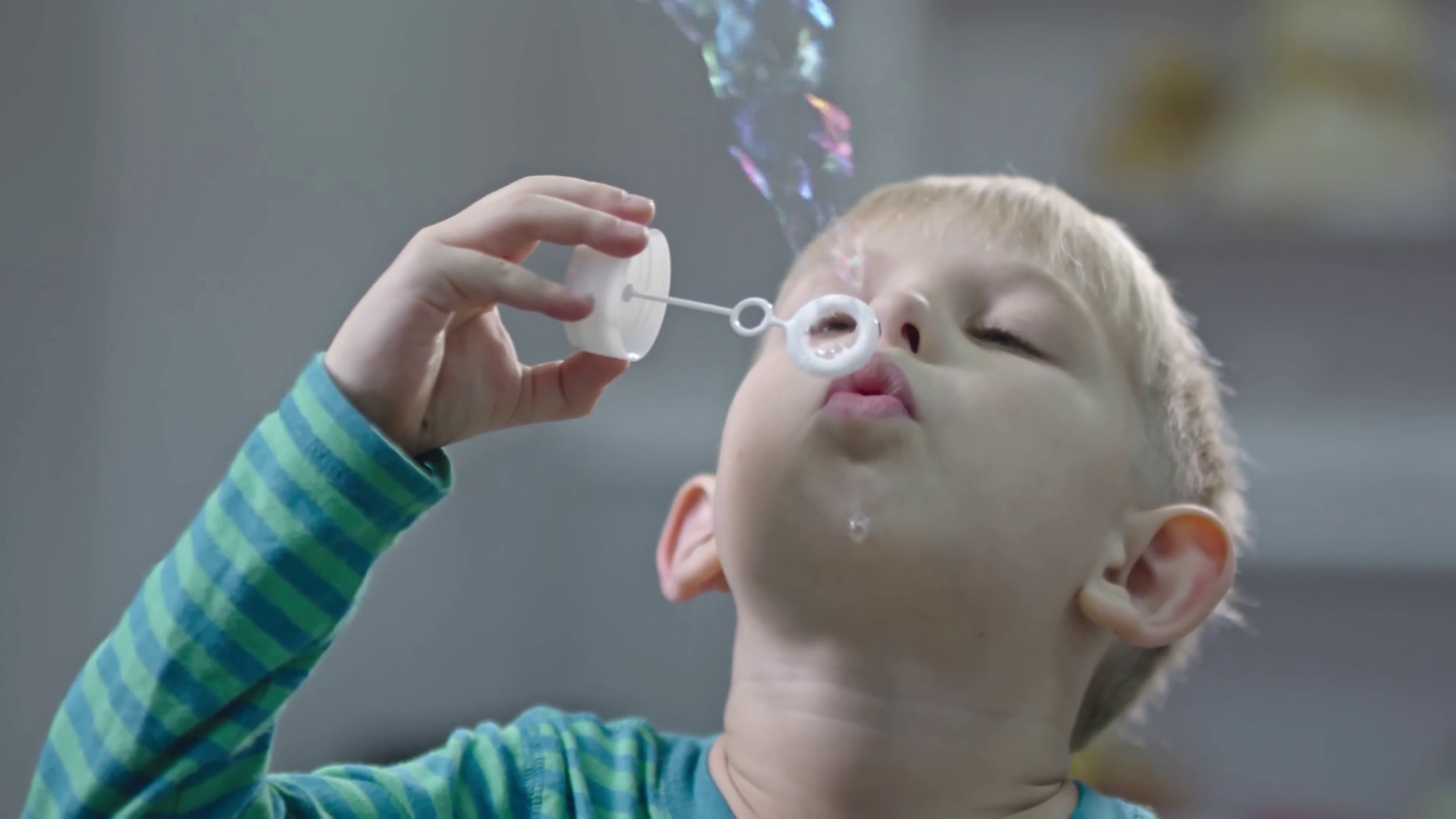 Little Boy in Slow Motion Blow Bubbles Into the Air in Winter. Stock ...
