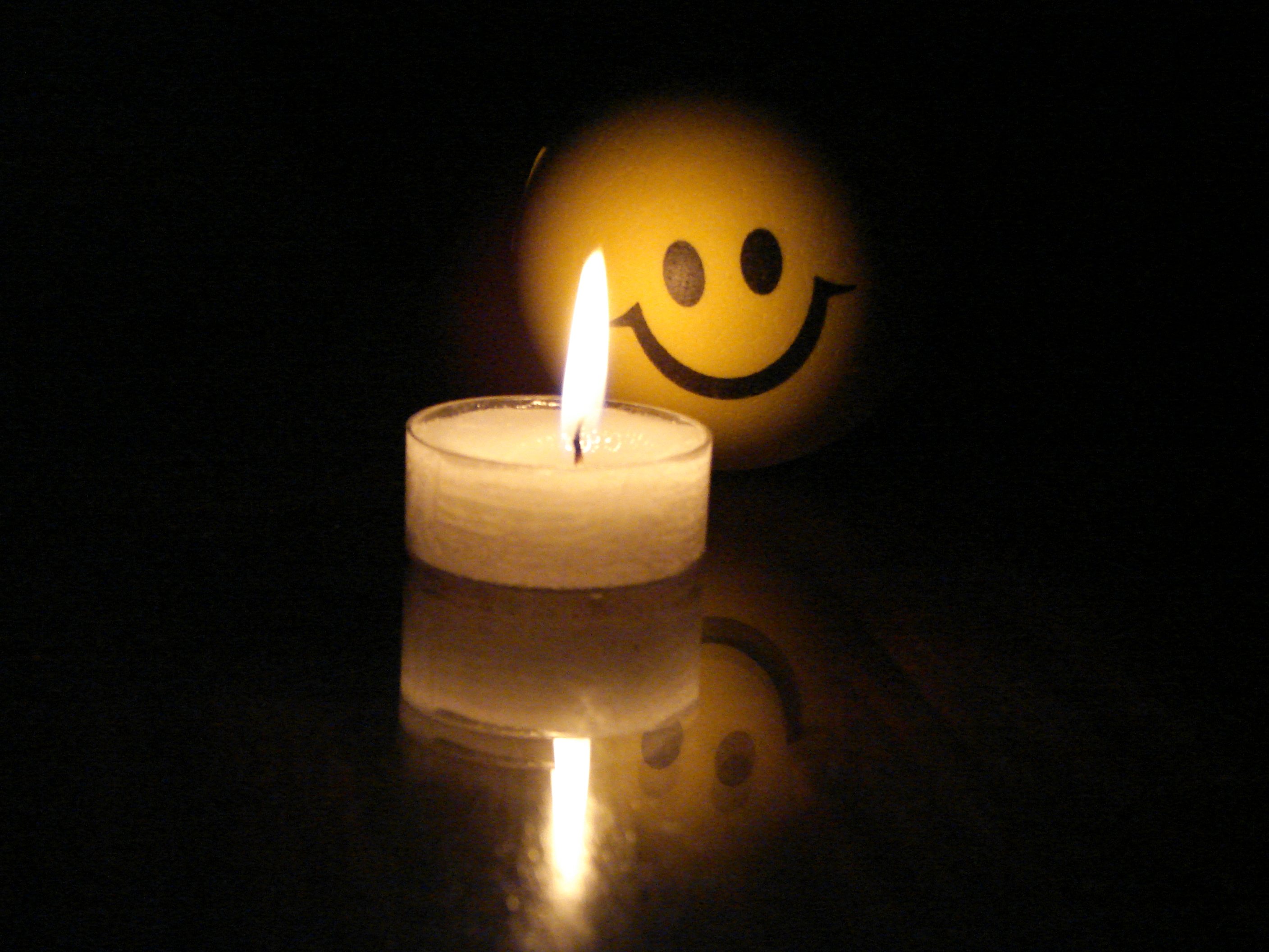 Little candle with funny face photo