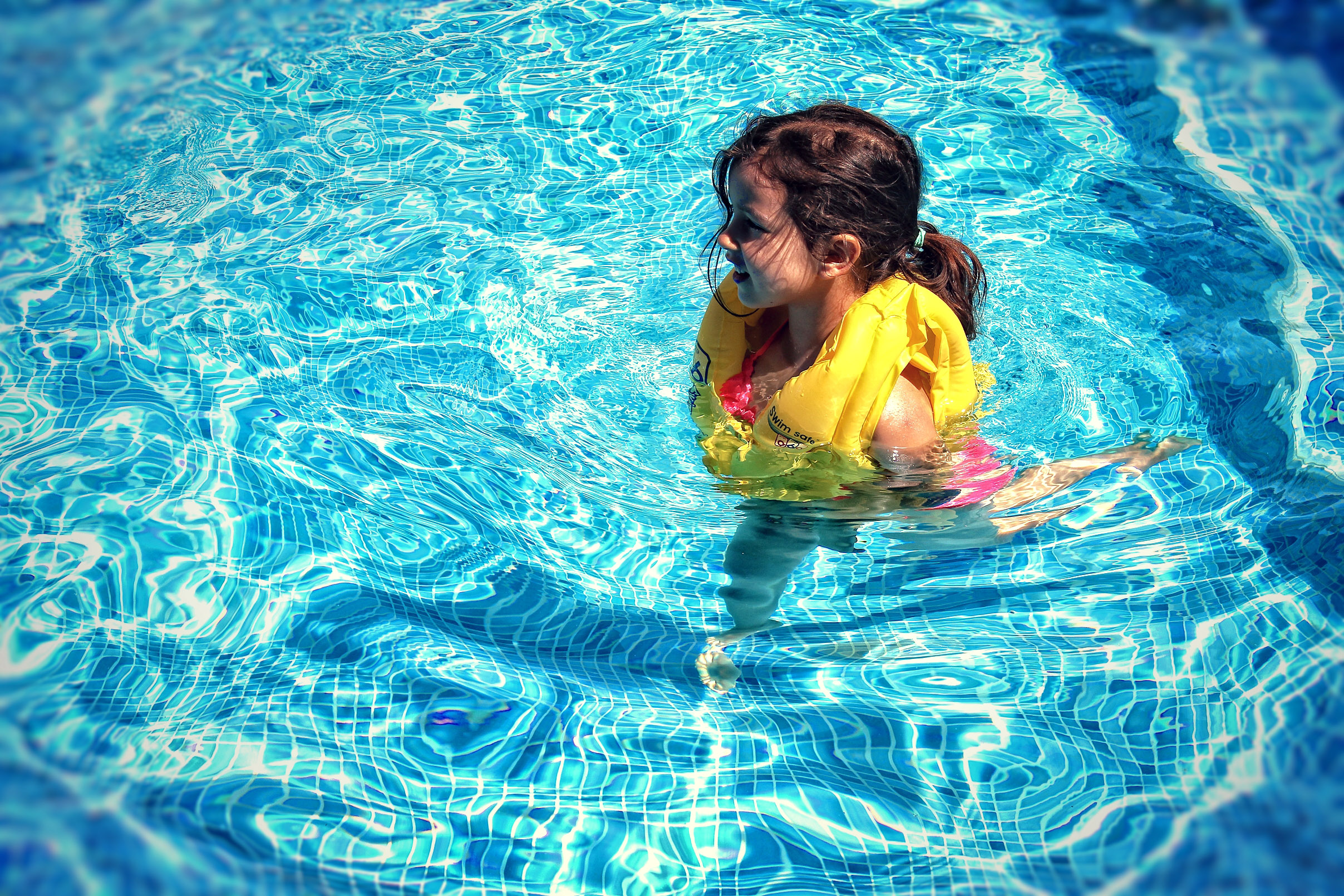 Little girl learning to swim photo