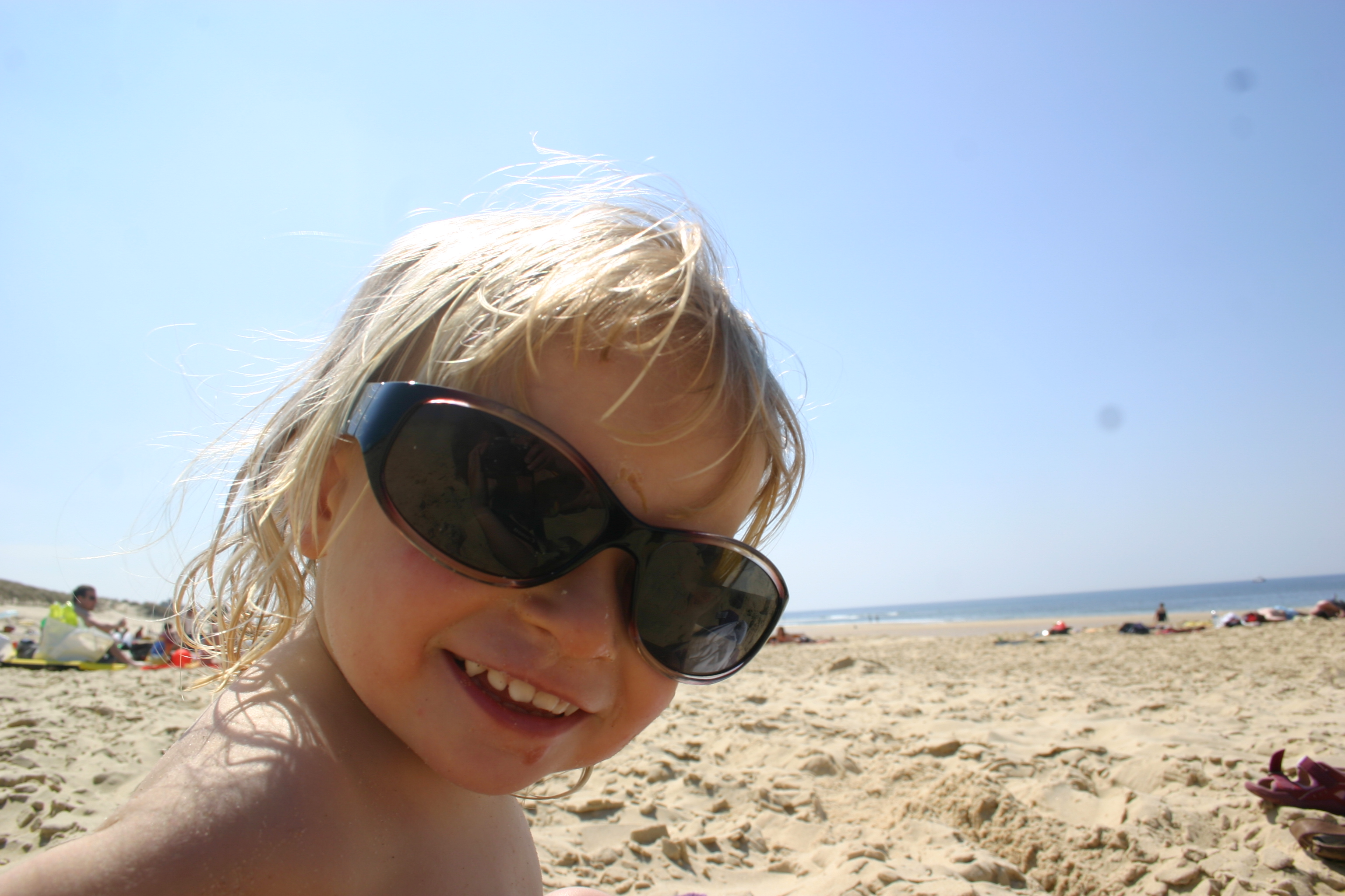 Little girl with too big sunglasses on t photo