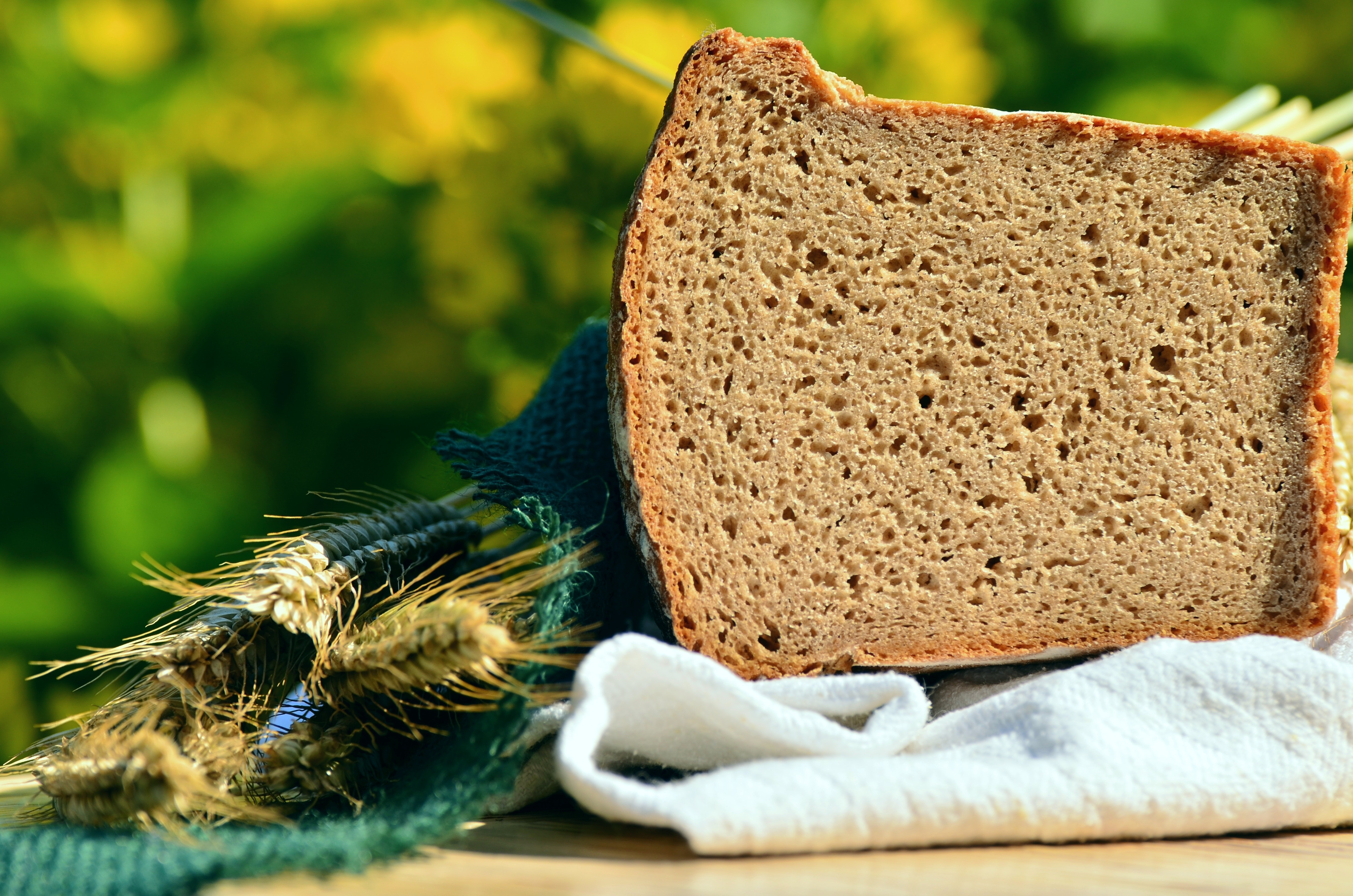 Loaf bread on top of white textile photo