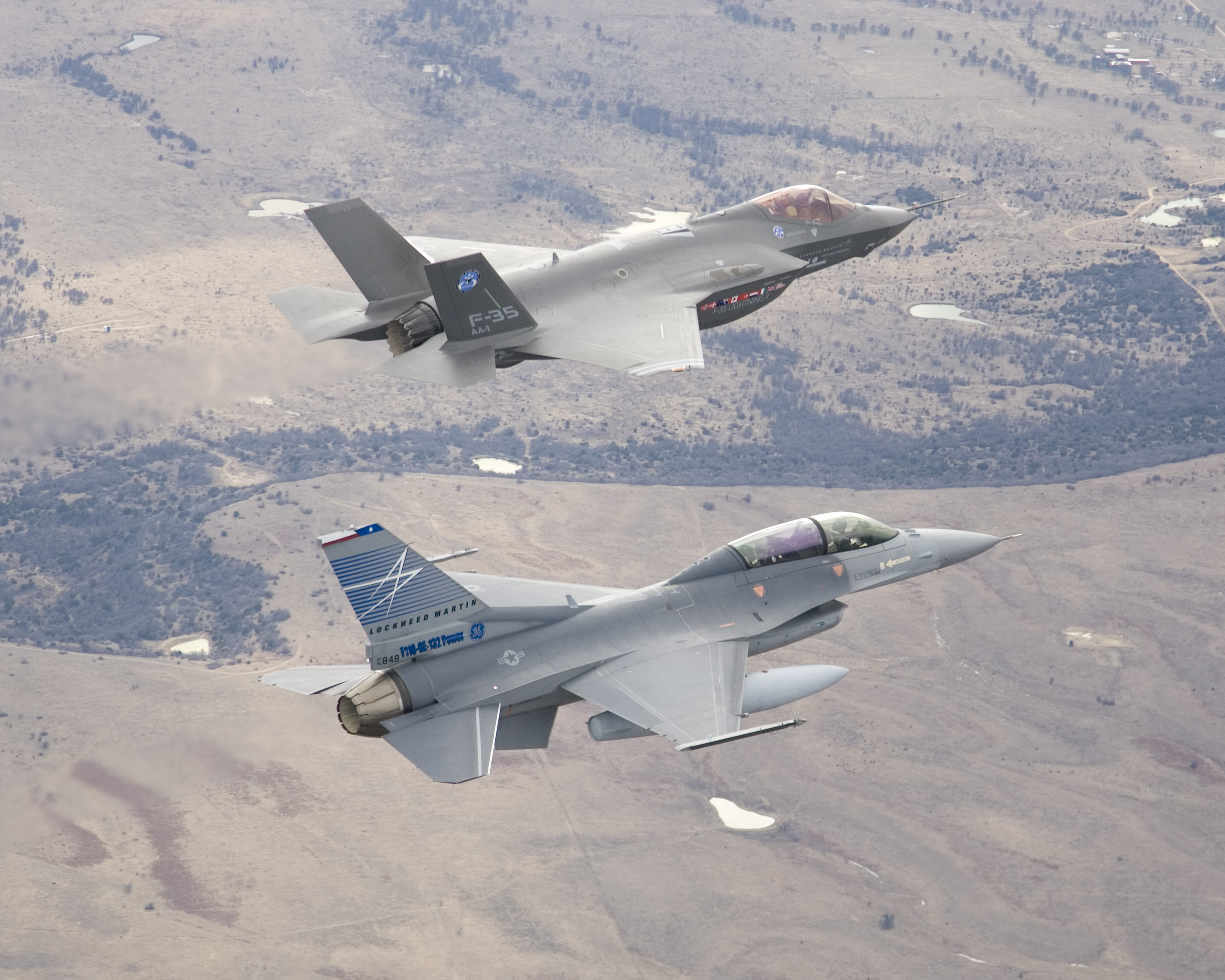 Lockheed Martin F-35A (AA-1) ''Lightning II'' an F-35A CTOL (conventional takeoff and landing) (test jet) with a General Dynamics F-16D ''Fighting Falcon'' (sn 90-0848) Chase Plane 2008, Aircraft, Airplane, Airplane wing, Outdoor, HQ Photo