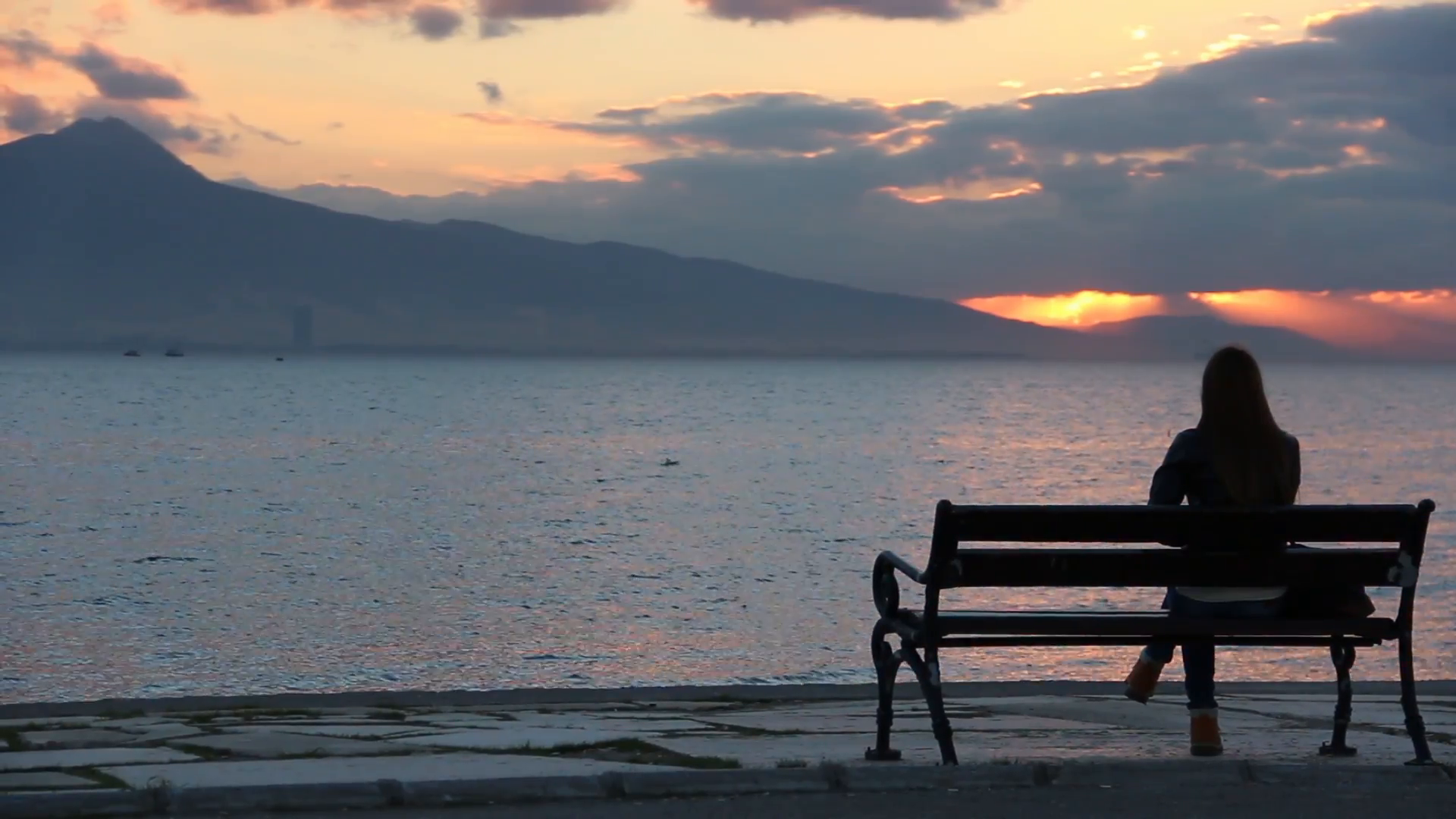 Lonely Girl Sitting on Bench At Sunset Stock Video Footage - Videoblocks