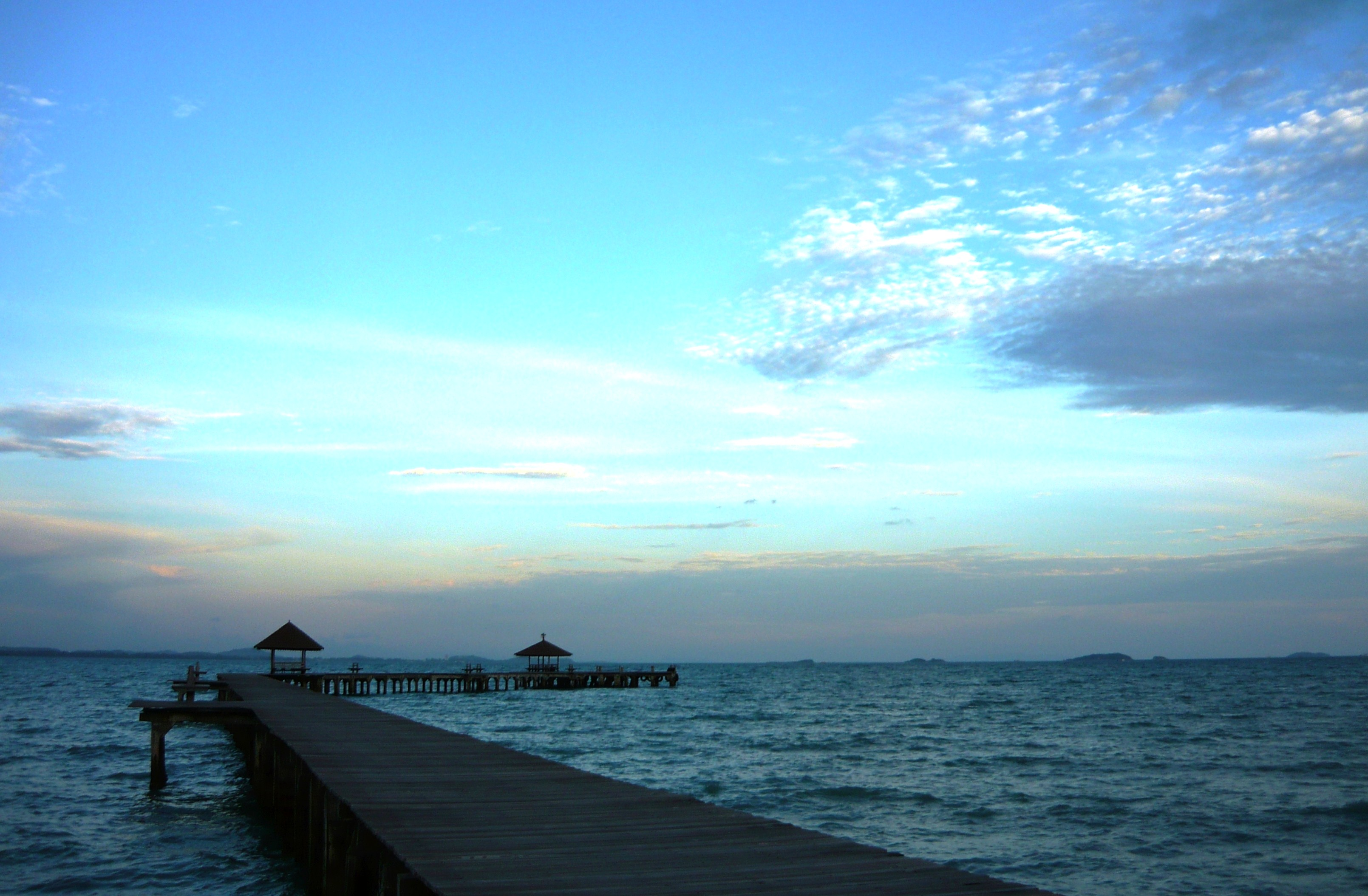 Long tropical pier at sunset photo