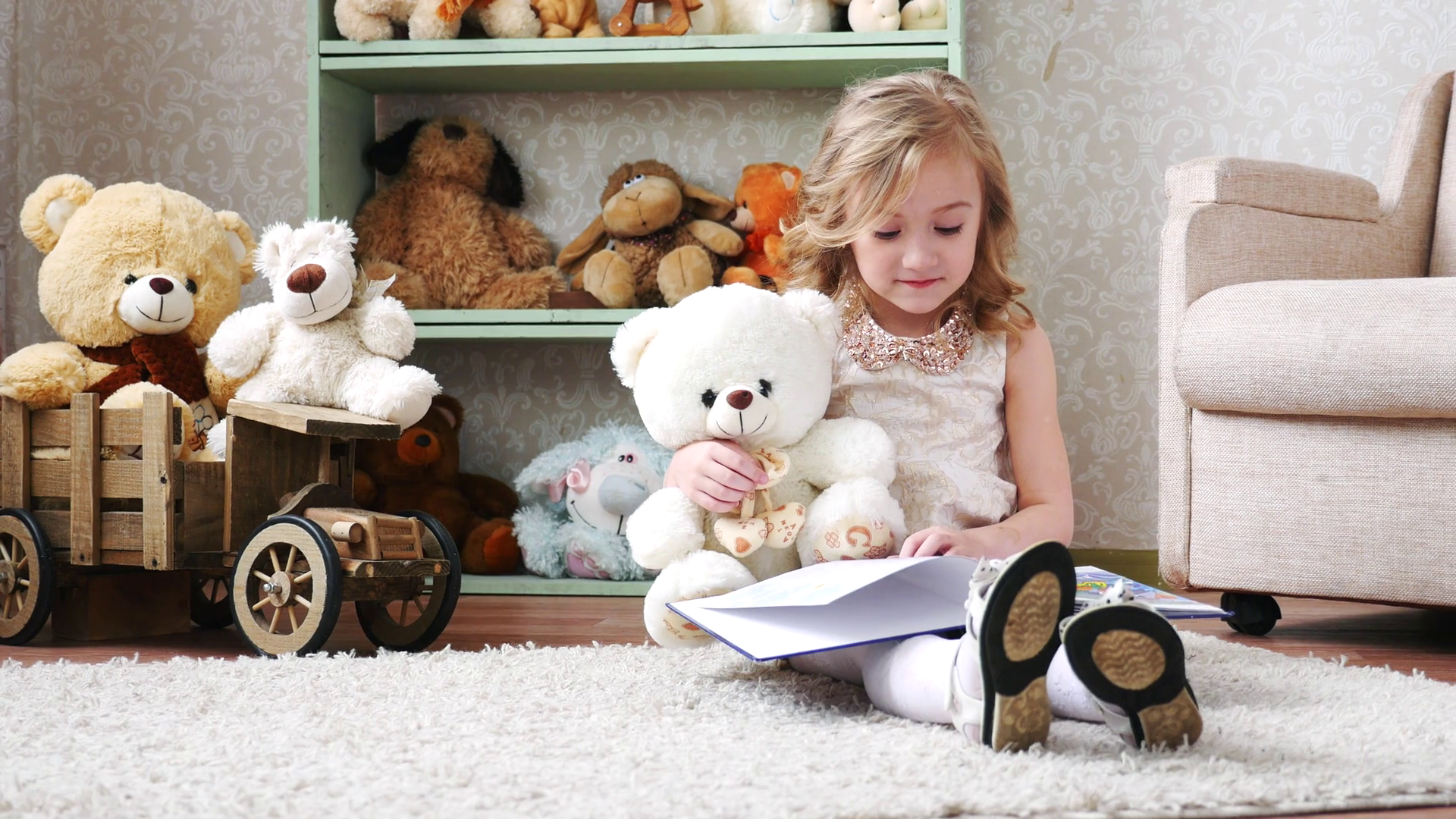 cute little girl reading a book with a teddy bear, play, have fun ...