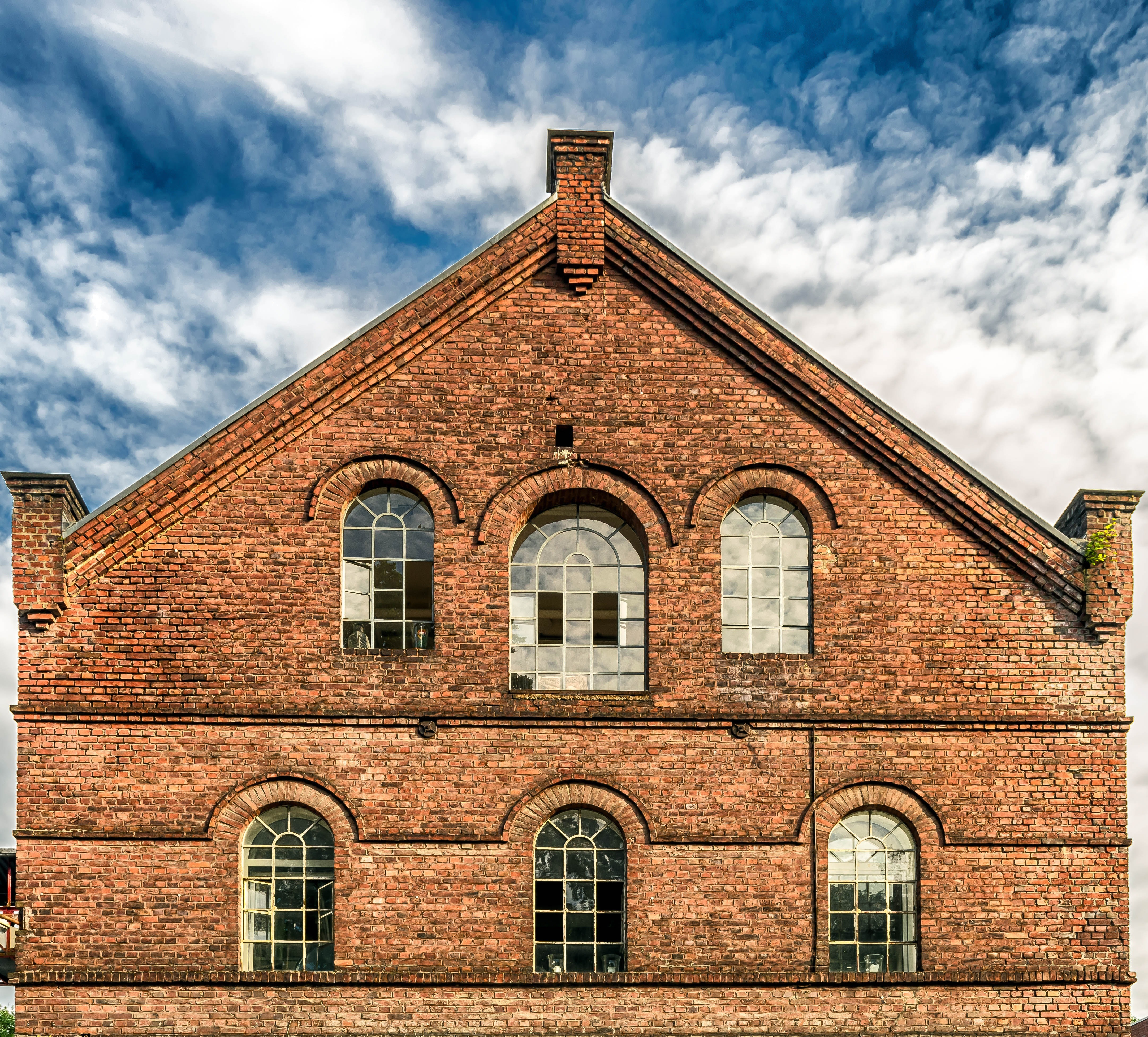 Low angle view of historic building against sky photo