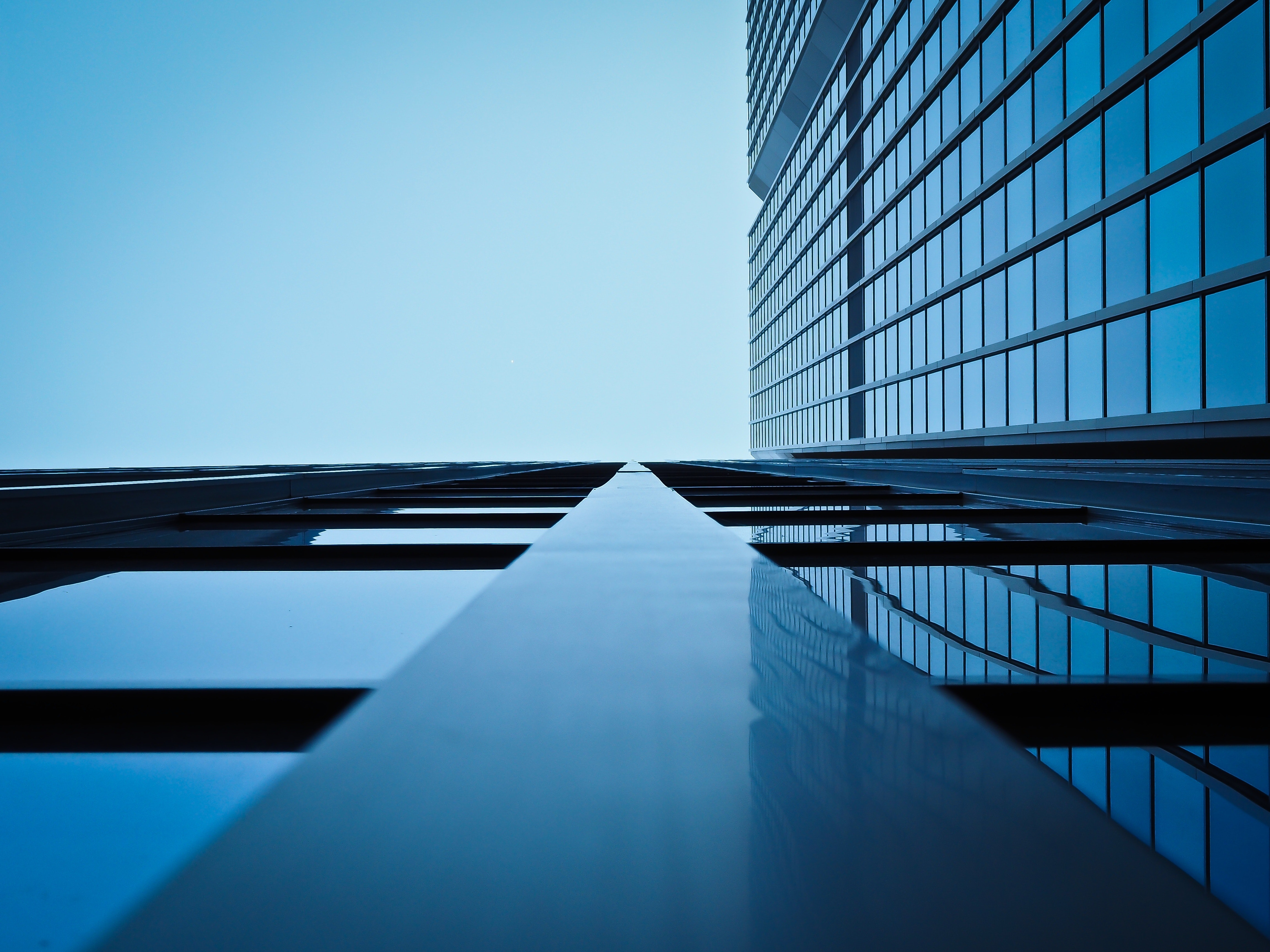 Low angle view of office building against clear sky photo