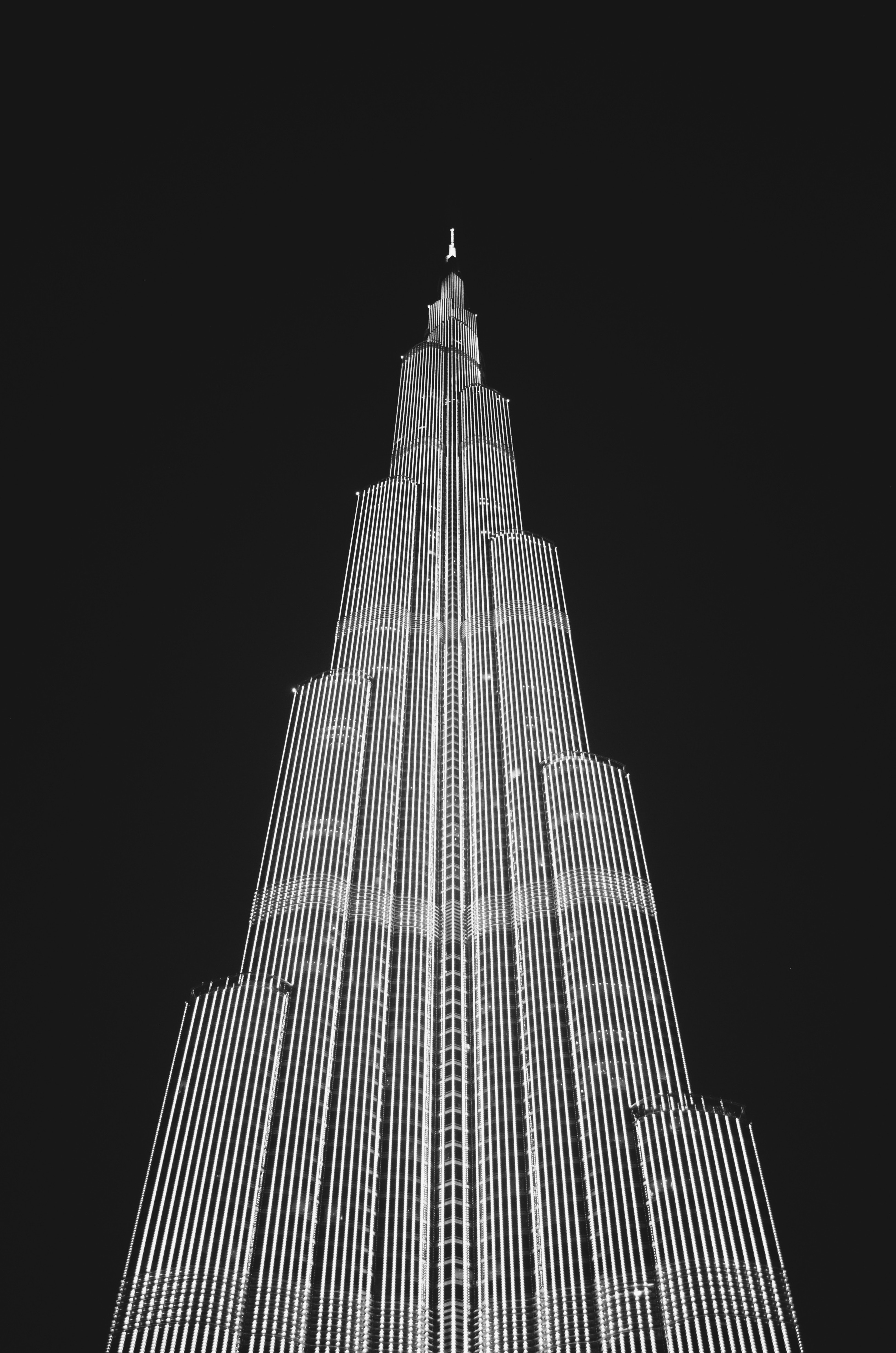 Low angle view of skyscraper against sky at night photo