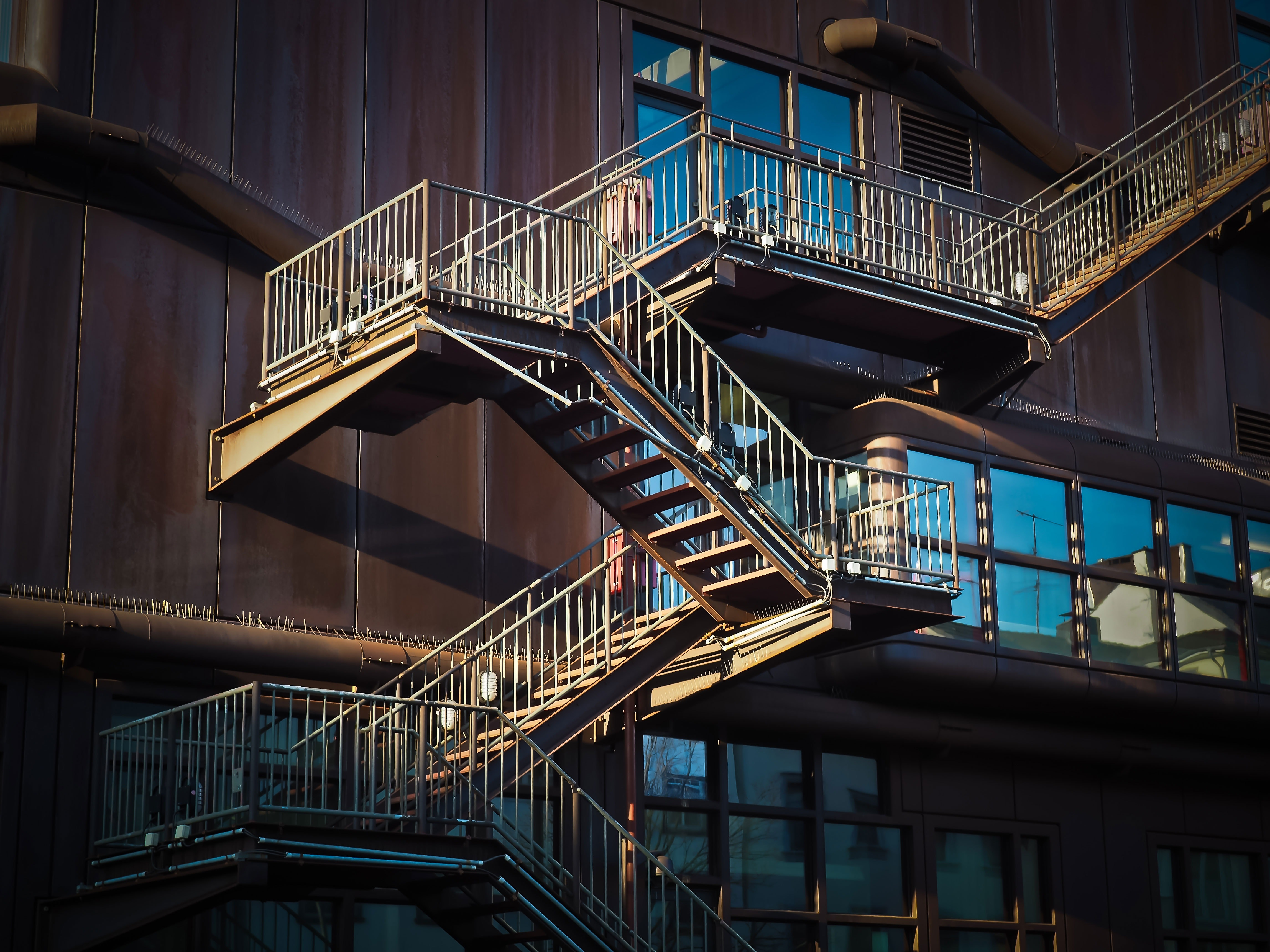 Low Angle View of Spiral Stairs, Rusty, Wood, Water, Urban, HQ Photo