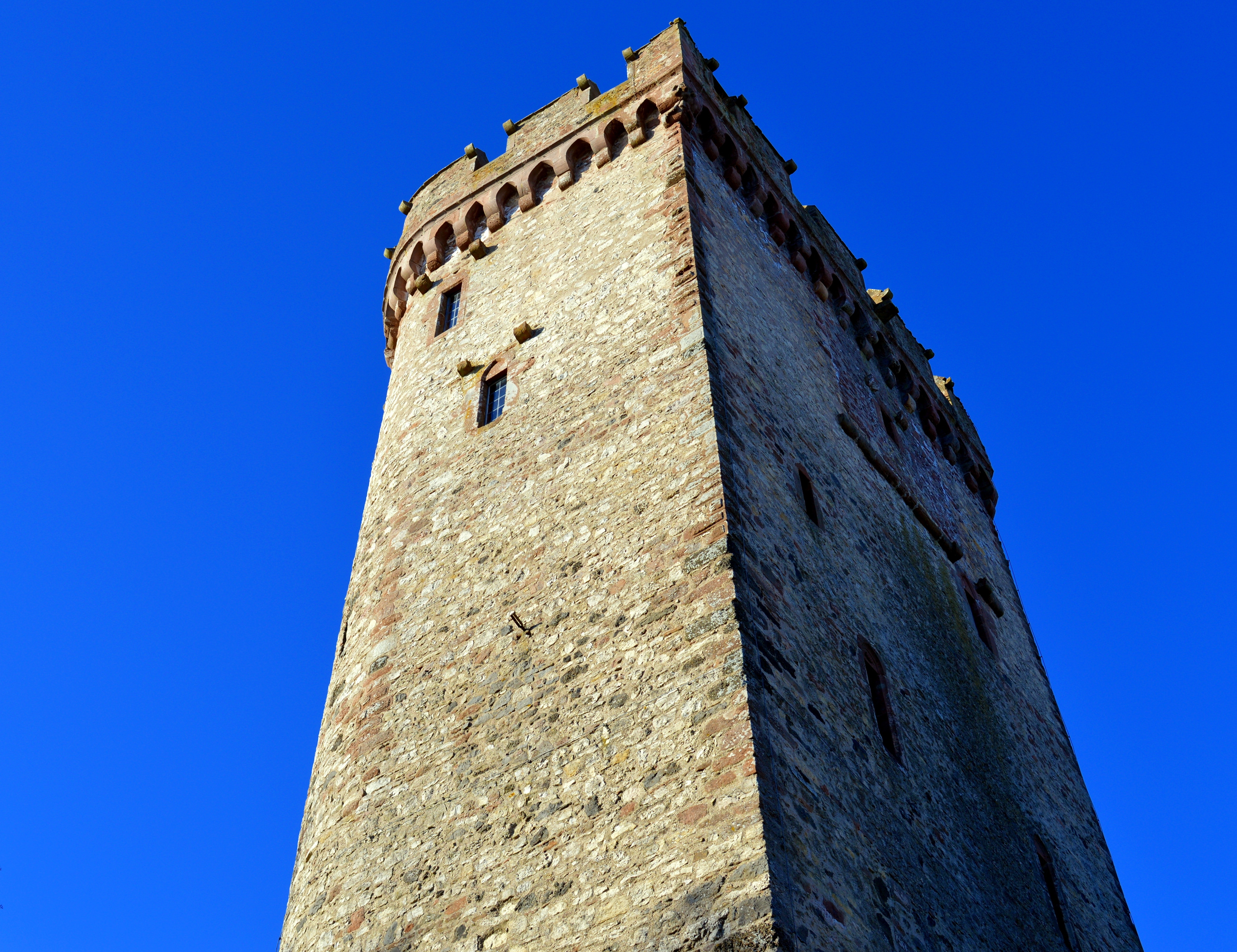 Low angle view of tower against clear blue sky photo