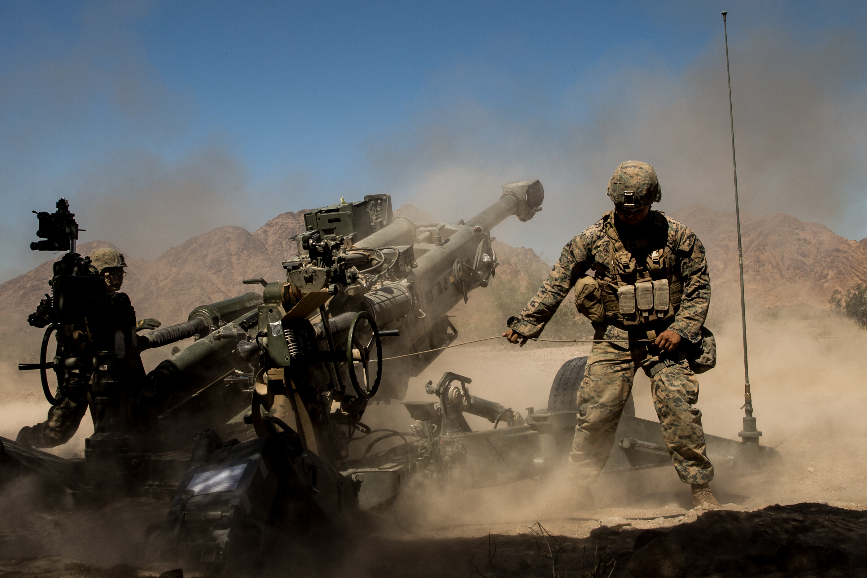M777 howitzer gun in action photo