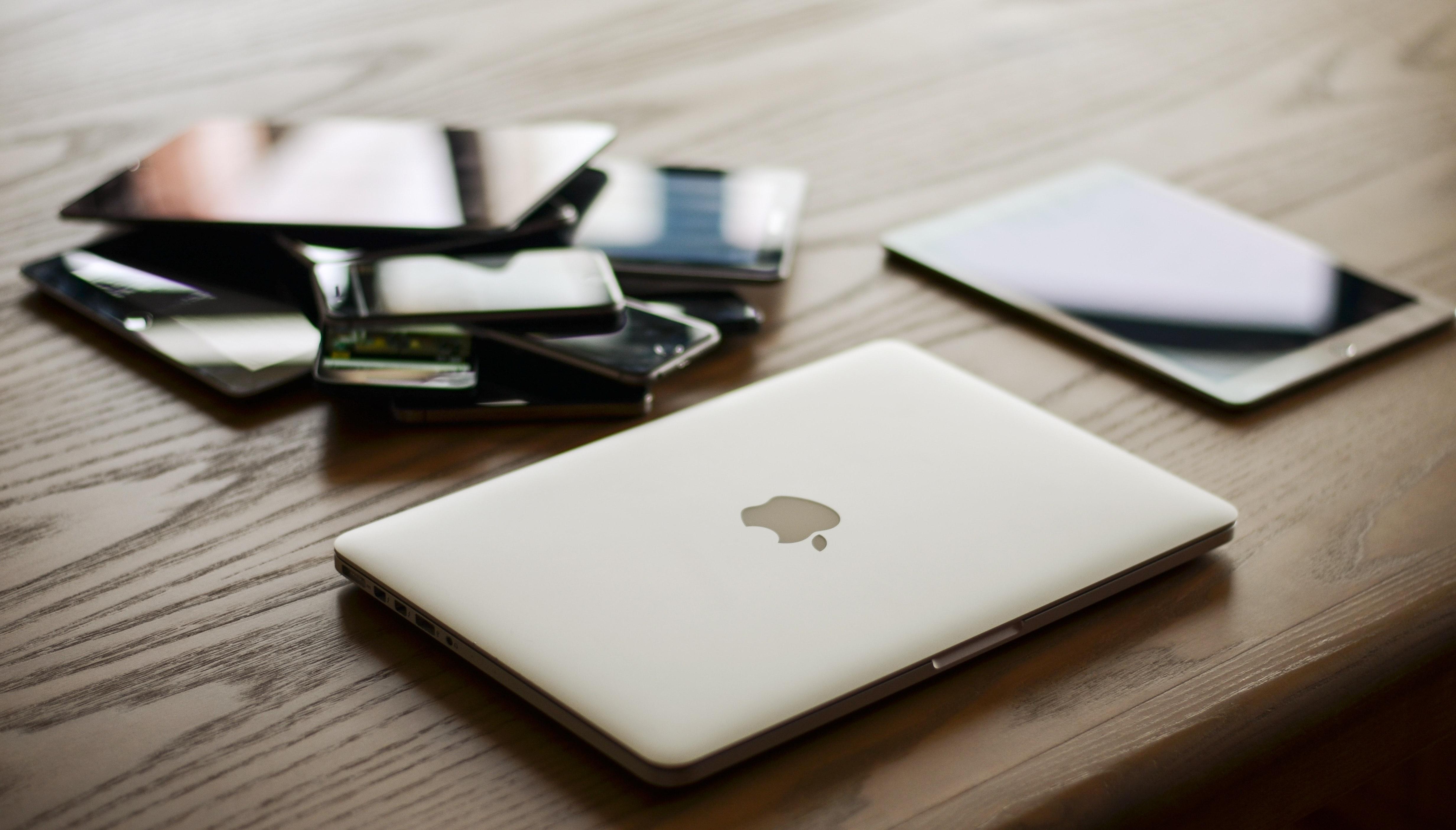Macbook and ipad on desk photo