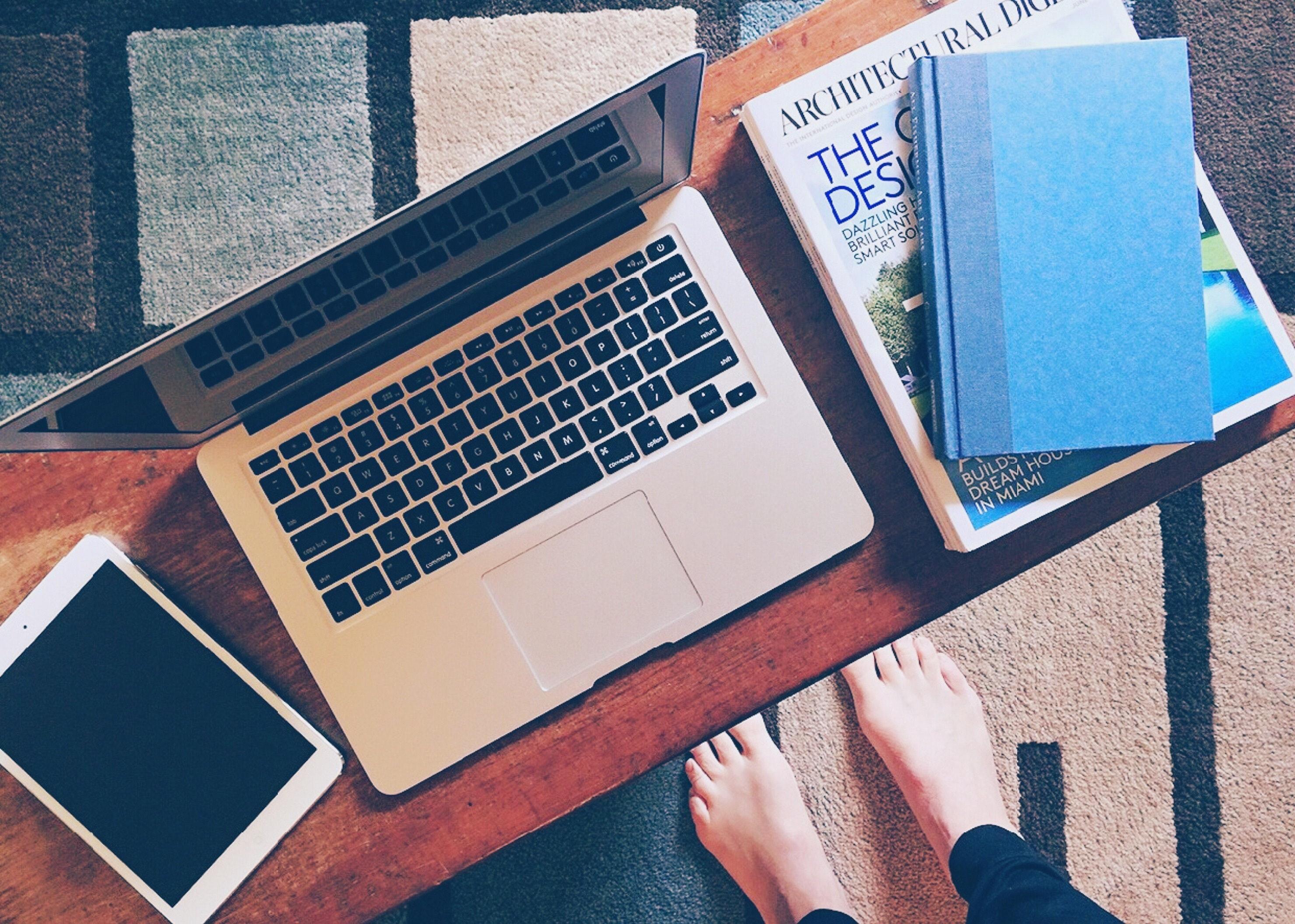 Macbook pro on brown wooden desk photo