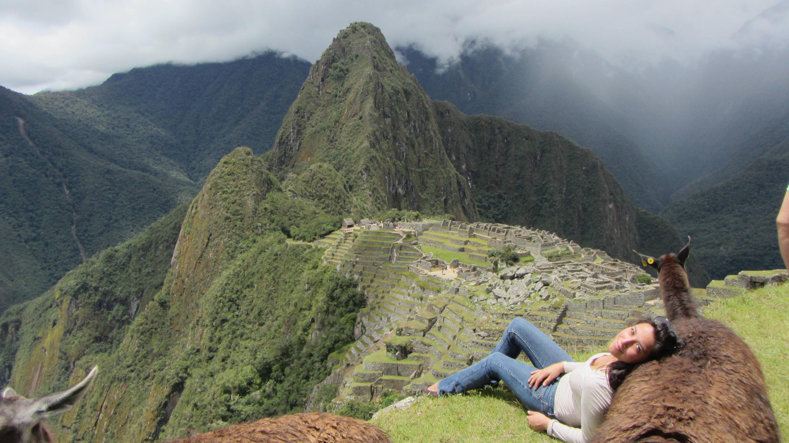 My sister resting on a llama at Machu Picchu. - Imgur
