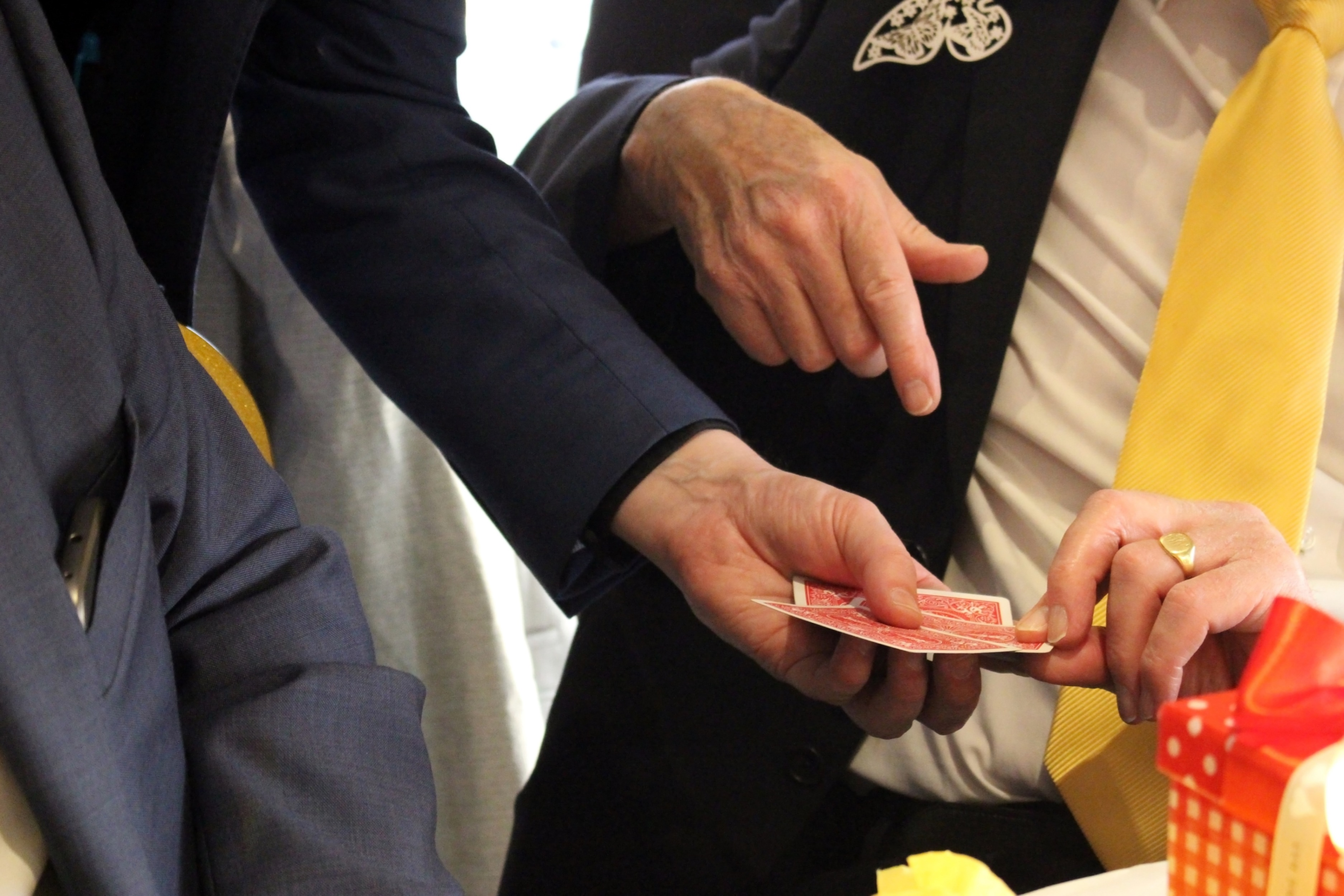 Magician gets a man to pick a card, Card, Male, Take, Suit, HQ Photo