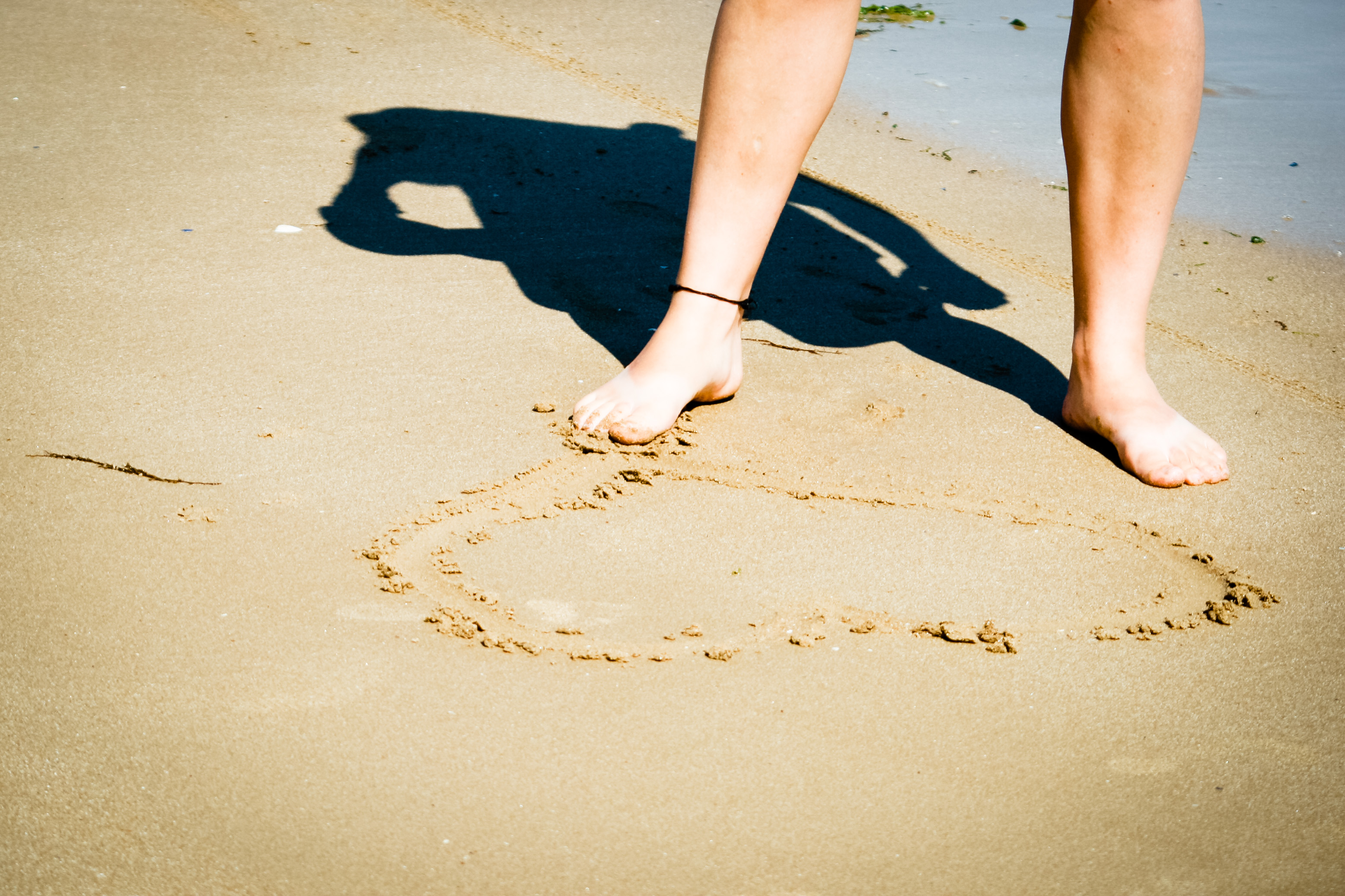 Making a heart in the sand photo