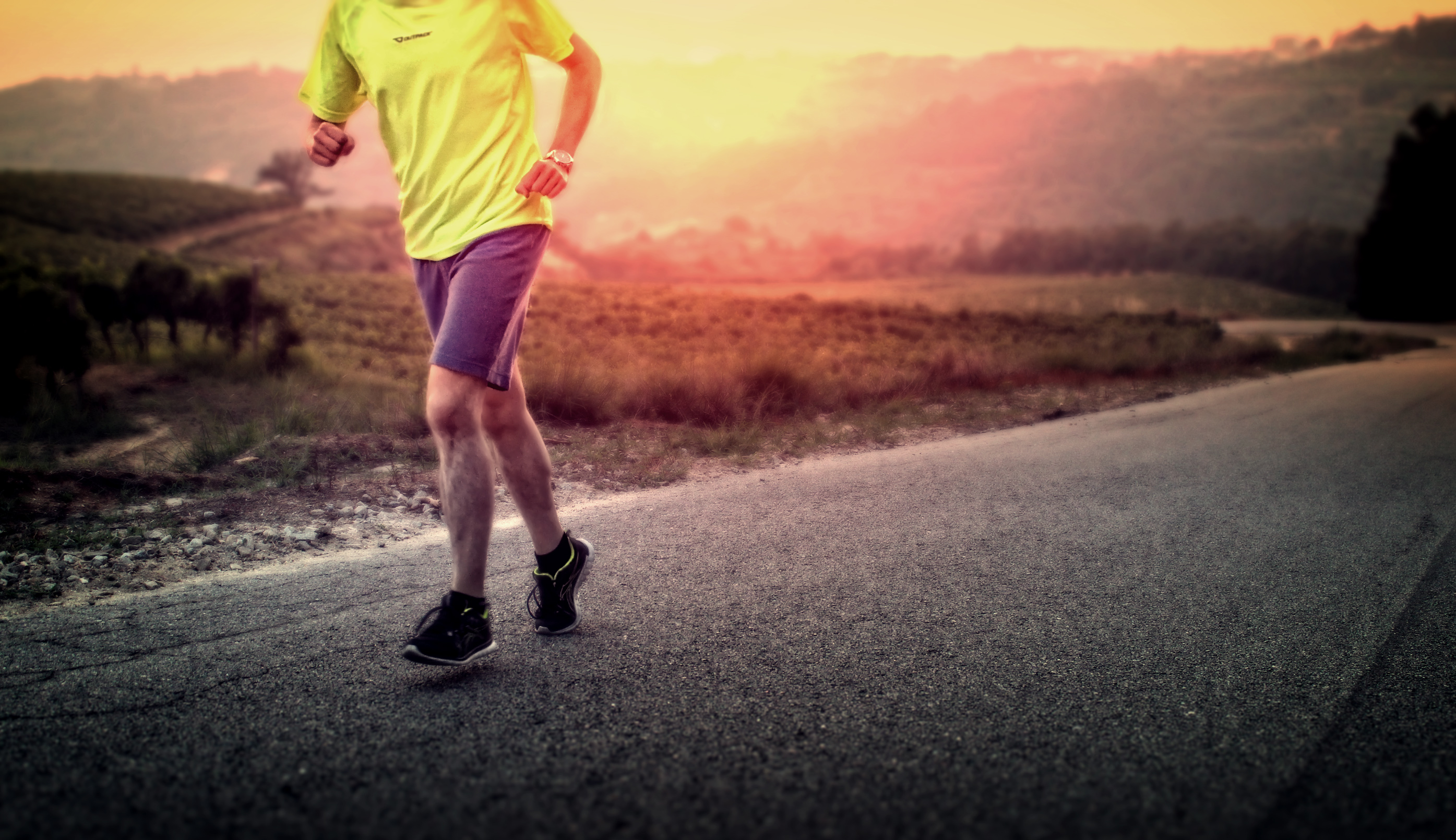 Male runner in the countryside at sunrise photo