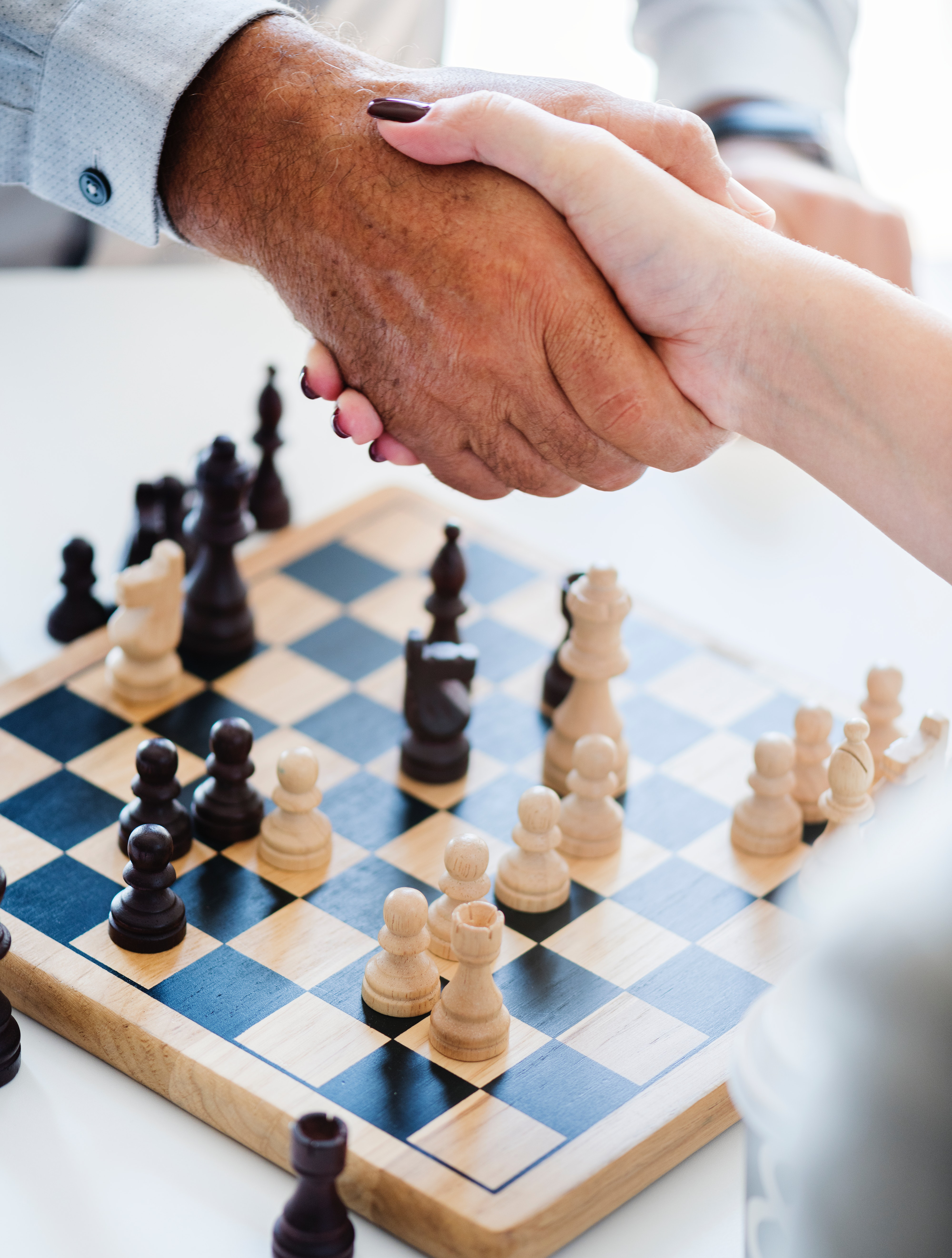 Man and Woman Shaking Hands over a Game of Chess, Black-and-white, Knight, White background, White, HQ Photo