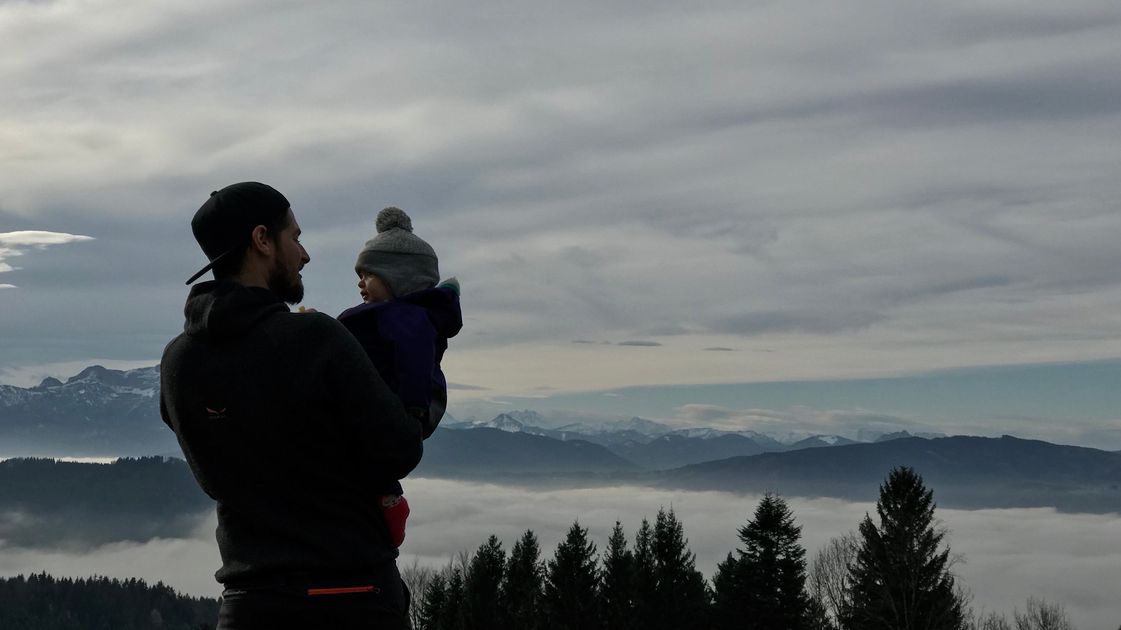 Man Holding a Baby Photo, Mountain peak, Trees, Snow, Sky, HQ Photo