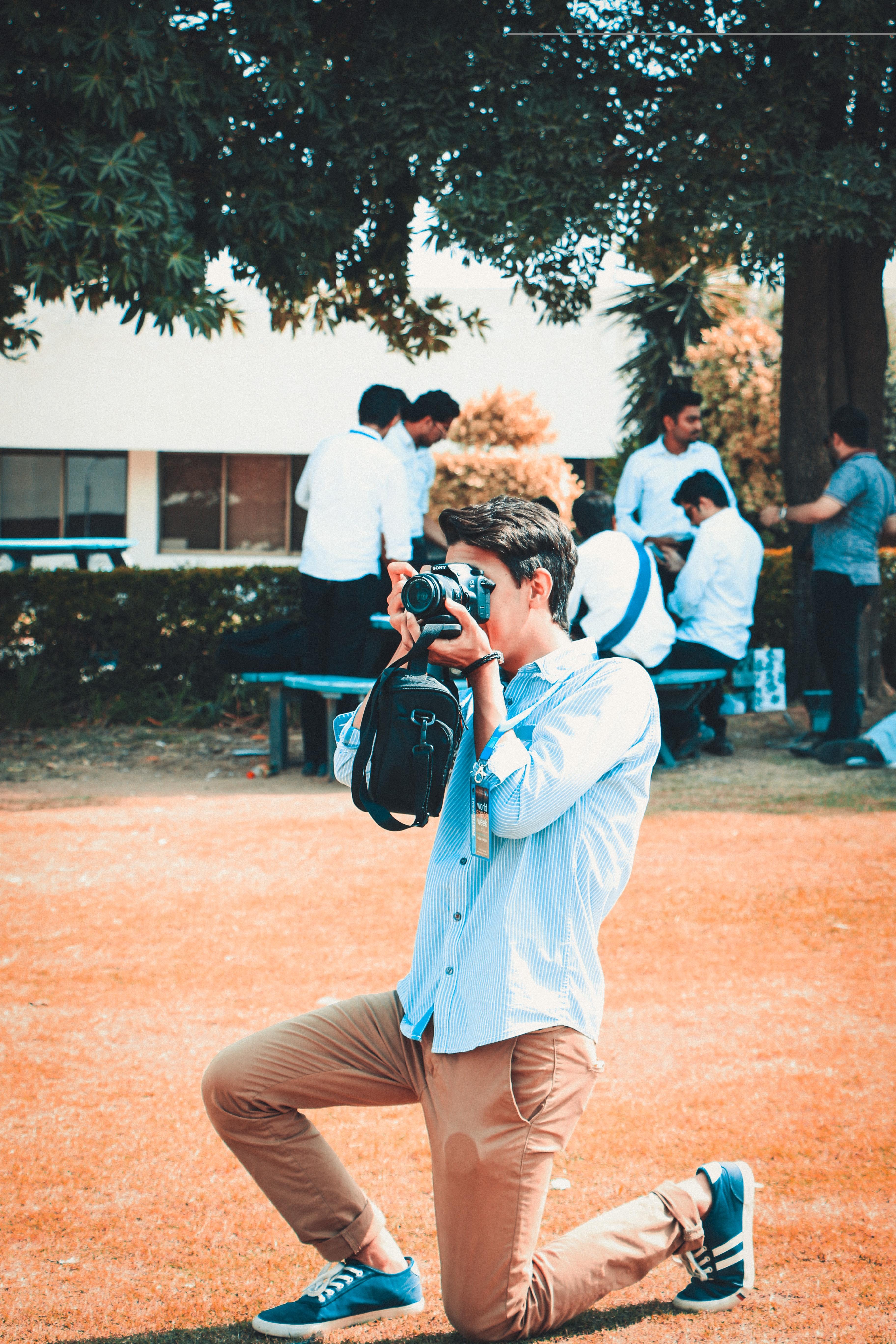 Man Holding a Black Dslr Camera, Camera, Daytime, Friends, Men, HQ Photo